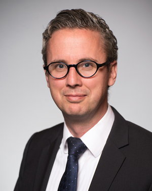 """Nik Schaefer (University Hospital Lausanne) is a trained oncologist and nuclear physician who will give a lecture on  """"The Clinical Implementation of Radiometal-based Radiopharmaceuticals and the Current/Future Challenges."""""""
