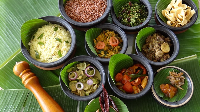 A delicious variety of Sri Lankan dishes, presented on banana leaves