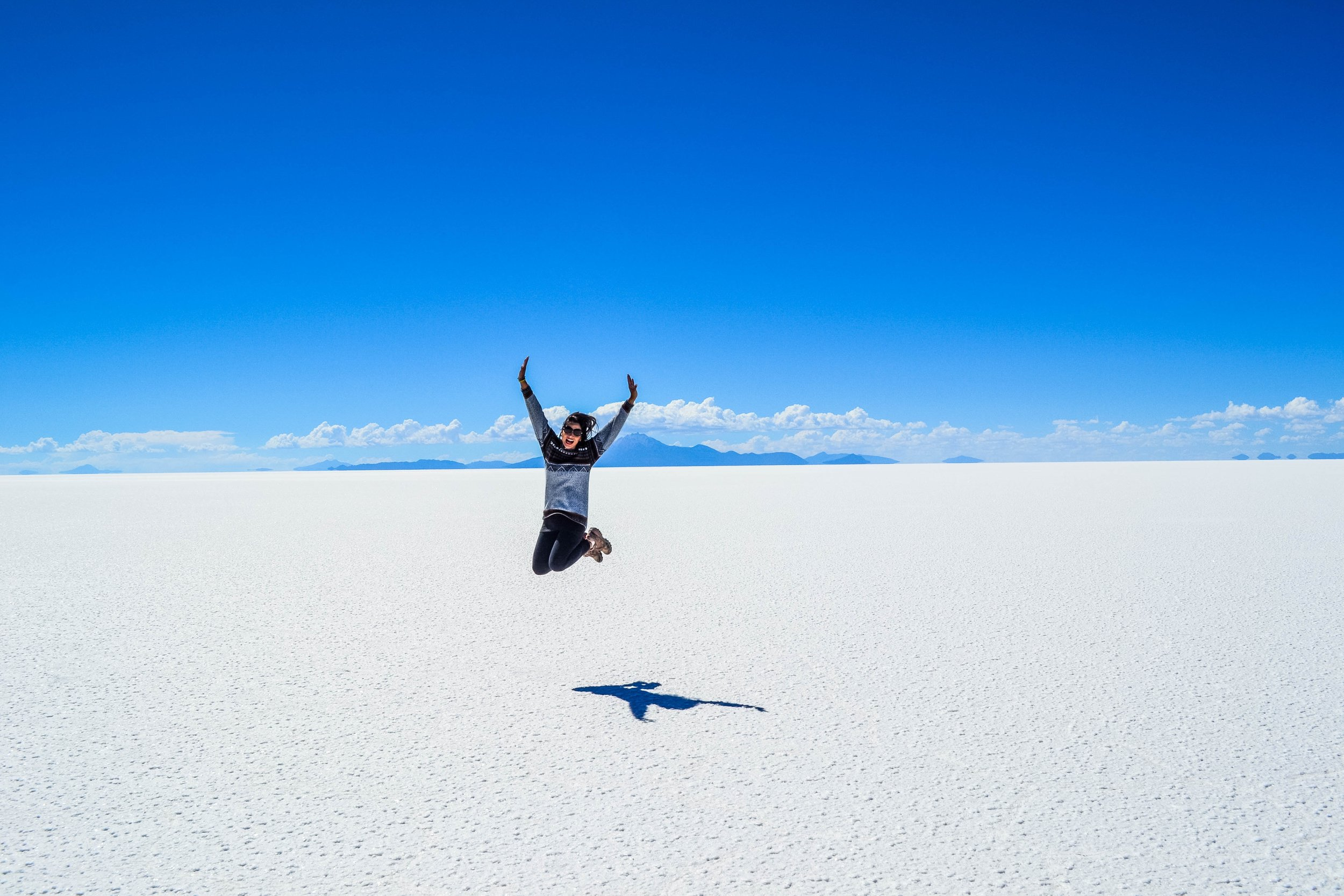 Jumping for joy at the Solar de Uyuni salt plains, Bolivia