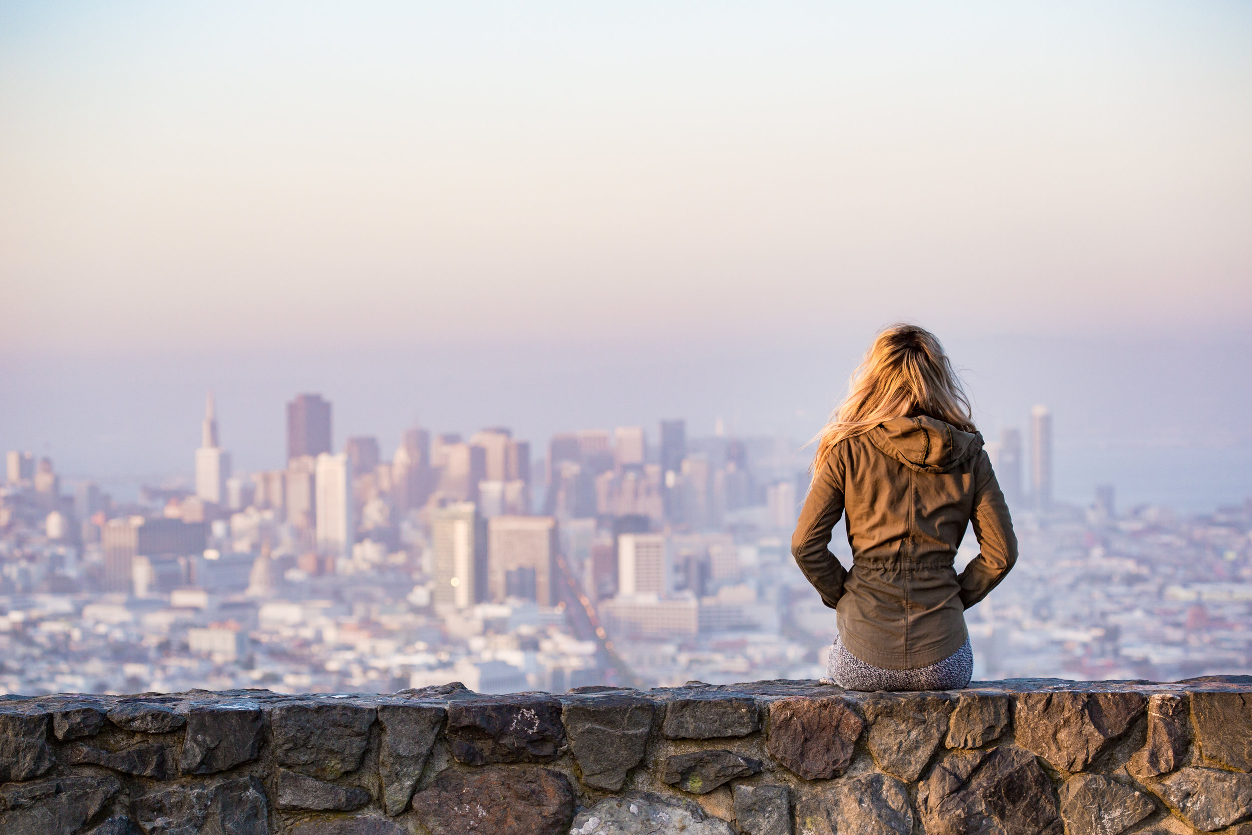 Girl looks out onto a cityscape