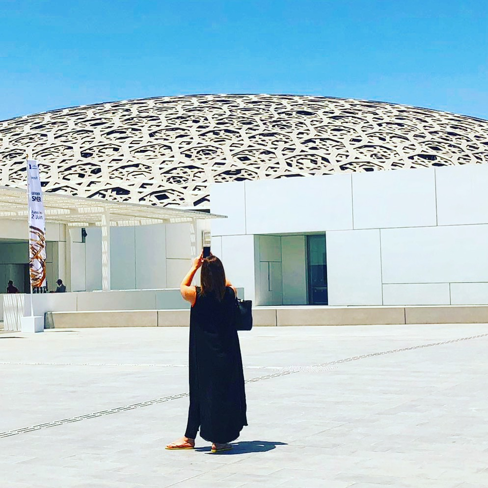 Contemporary Class Editor, Katie Silcox, takes a photo of The Louvre, Abu Dhabi