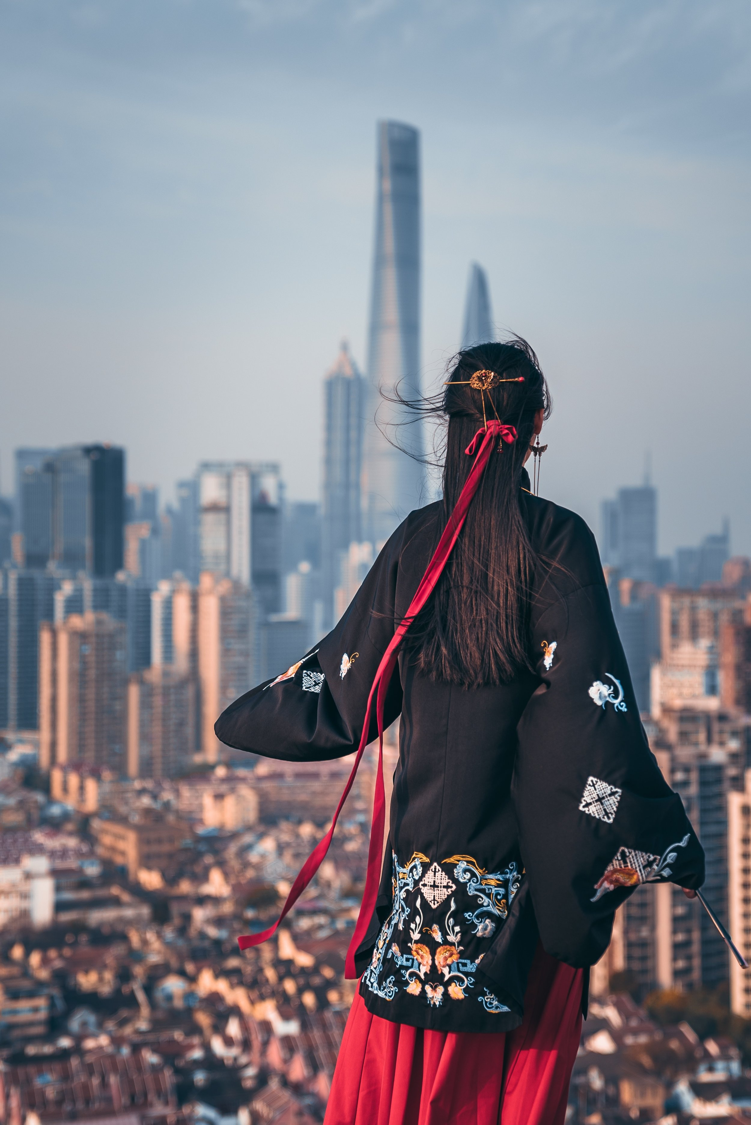 Girl overlooks the Bund, Shanghai. Photo Credit: Yiran Ding
