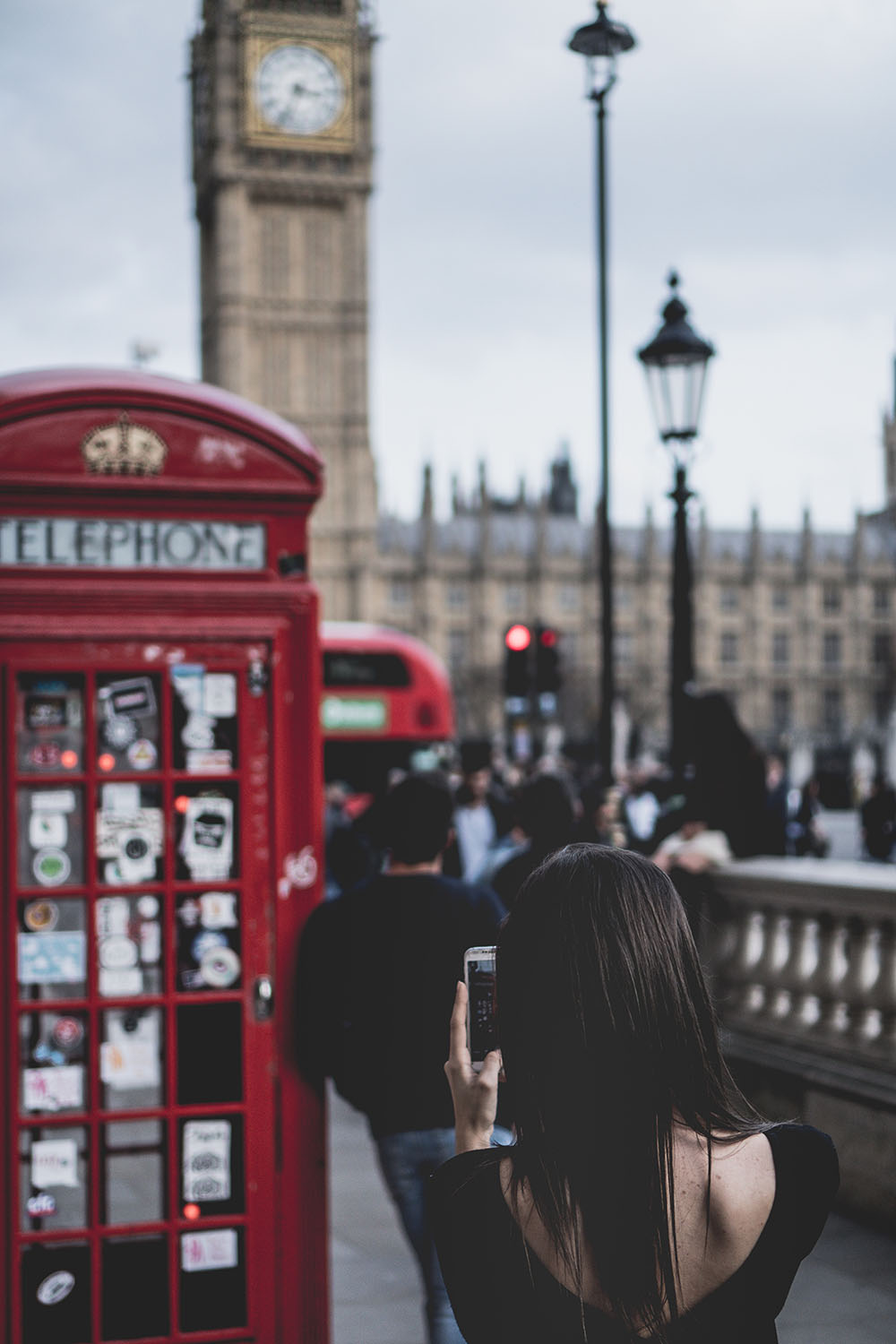 A red phone box in front of Big Ben, London. Photo Credit: Paul Gilmore