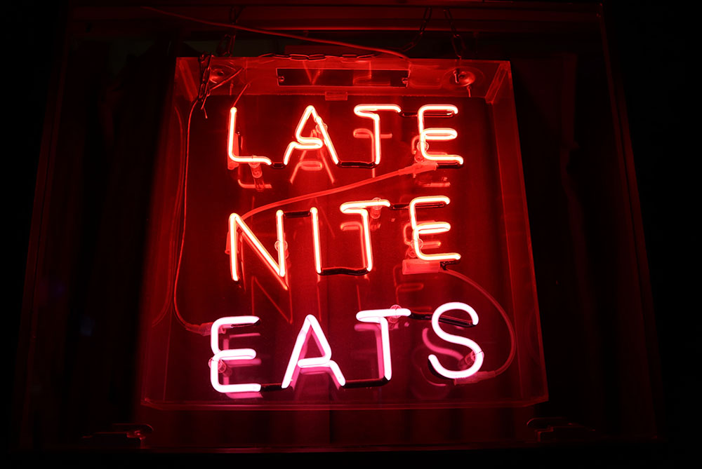 Neon sign for late night eats, London. Photo Credit: Frederick Tubiermont