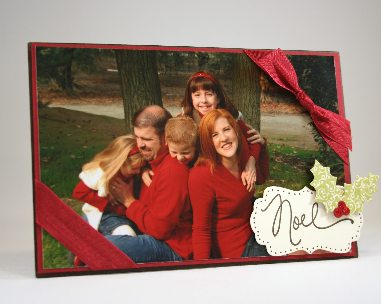 The Christmas Card that stands up! I created this using the  Card and Photo Easel Die ,which also includes the holly leaf shapes.