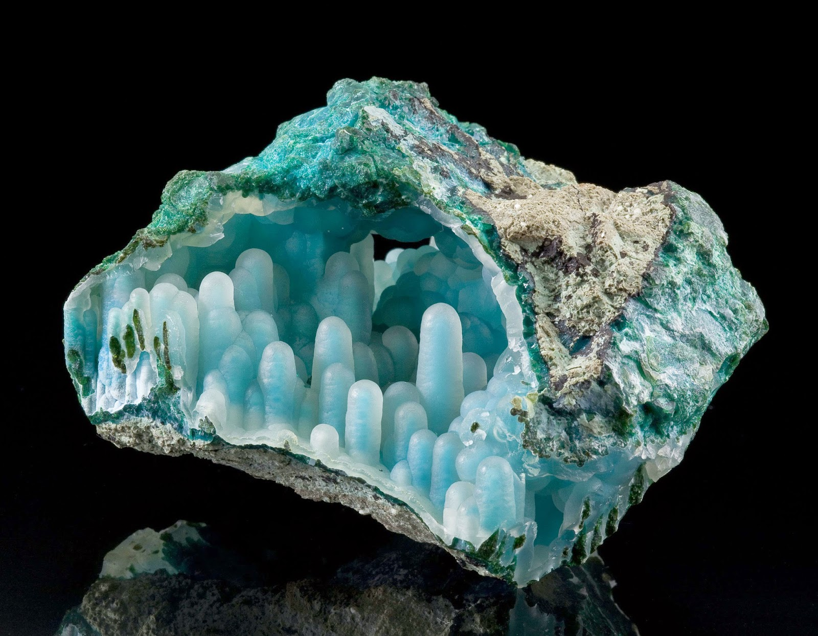 A  geode  pocket of chalcedony on chrysocolla stalactites. Classic example of the quartz-covered chrysocolla stalactites ( stalactitic  aggregate) From Inspiration Mine, AZ