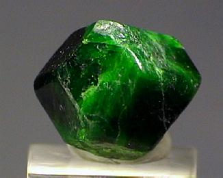 Deep pine green crystal of chrome andradite with  dodecahedral  crystal form.