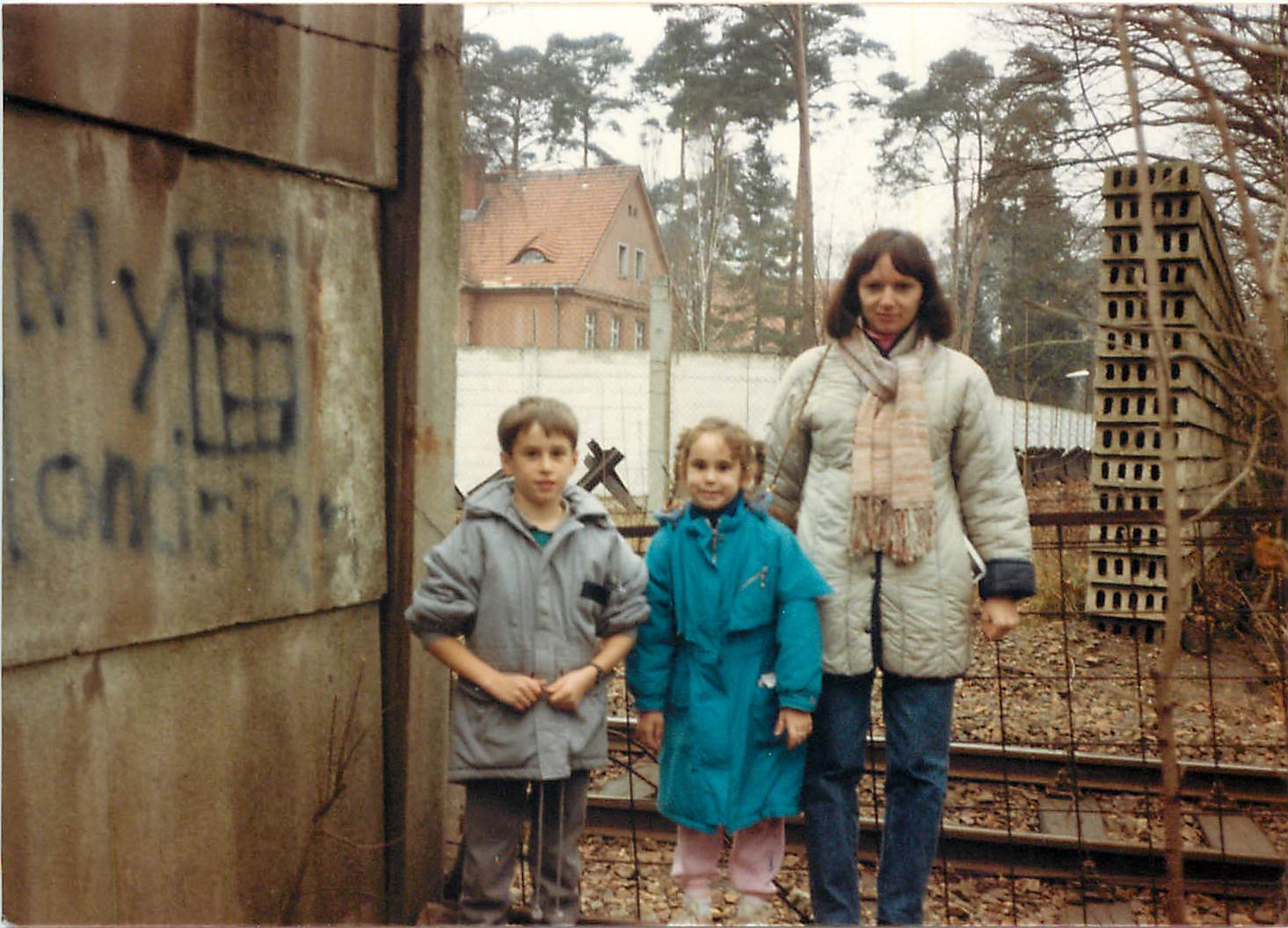 Troy and Karla with mom, Connie, in West Berlin at the Berlin Wall in the late 1980's.