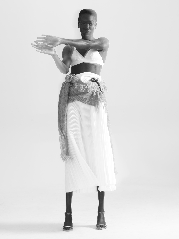 Dress (worn as skirt): Sacai / Bra: Araks / Shoes: Brother Vellies