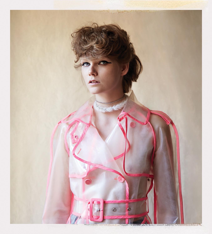 coat  WANDA NYLON  courtesy of Albright Fashion Library  underwear: ARAKS  jewelry : MARLAND BACKUS DESIGN