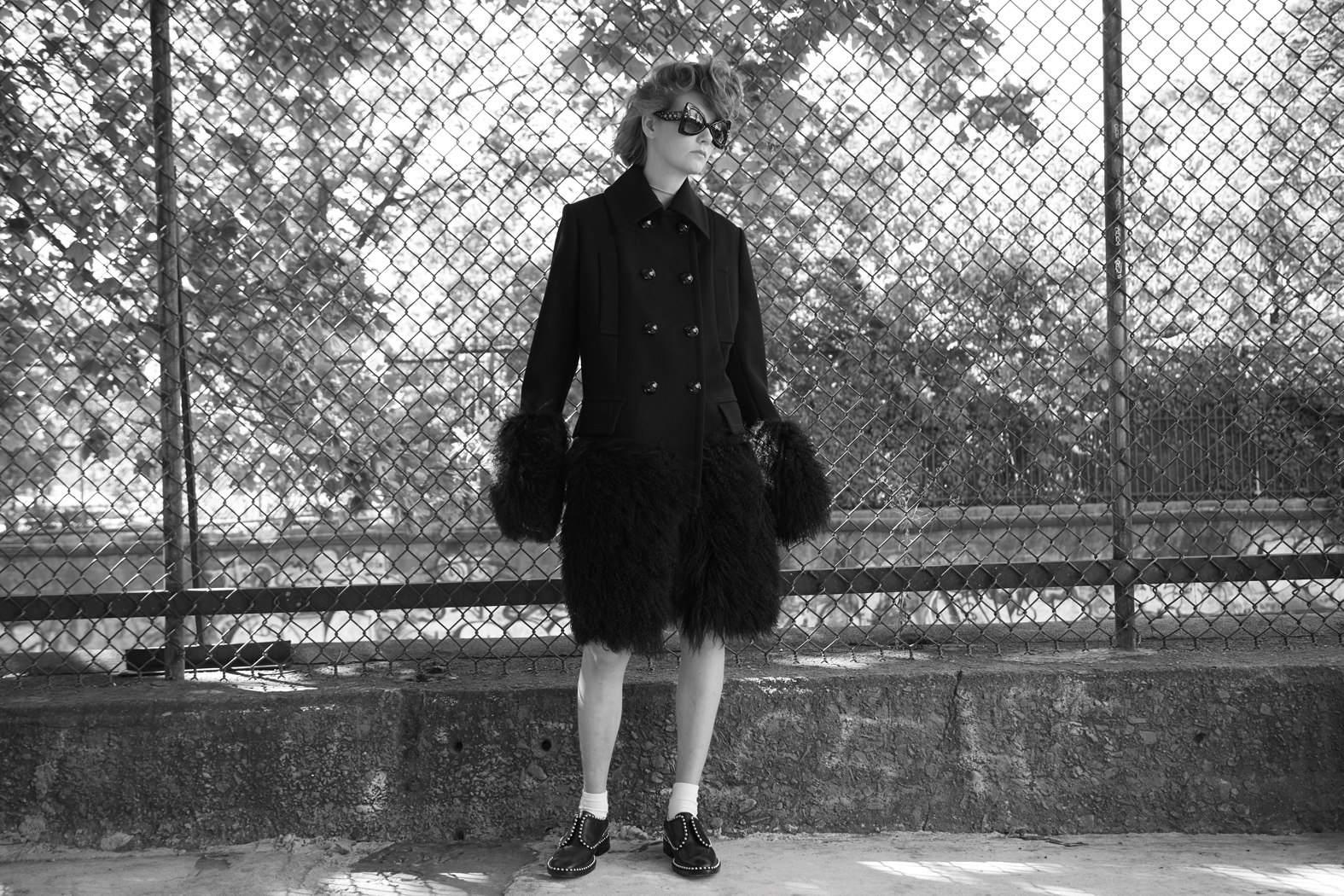 coat : SACAI sunglasses: ROBERTO CAVALLI  shoes : ALEXANDER WANG  courtesy of  ALBRIGHT FASHION LIBRARY  socks : FOGAL