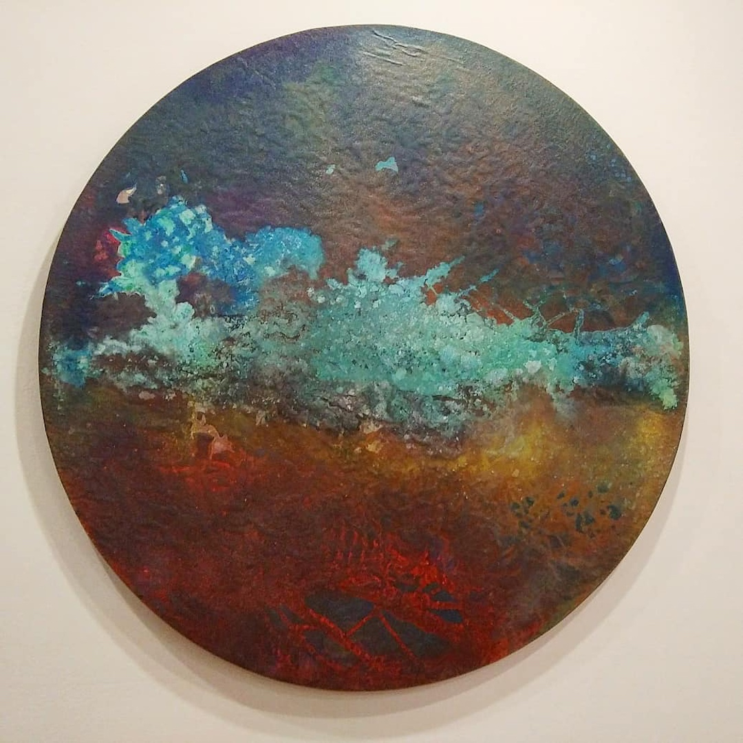 """Beautiful Devastation 2017 48"""" diameter canvas on panel with graphite mica, copper patina, pigment and polymer."""