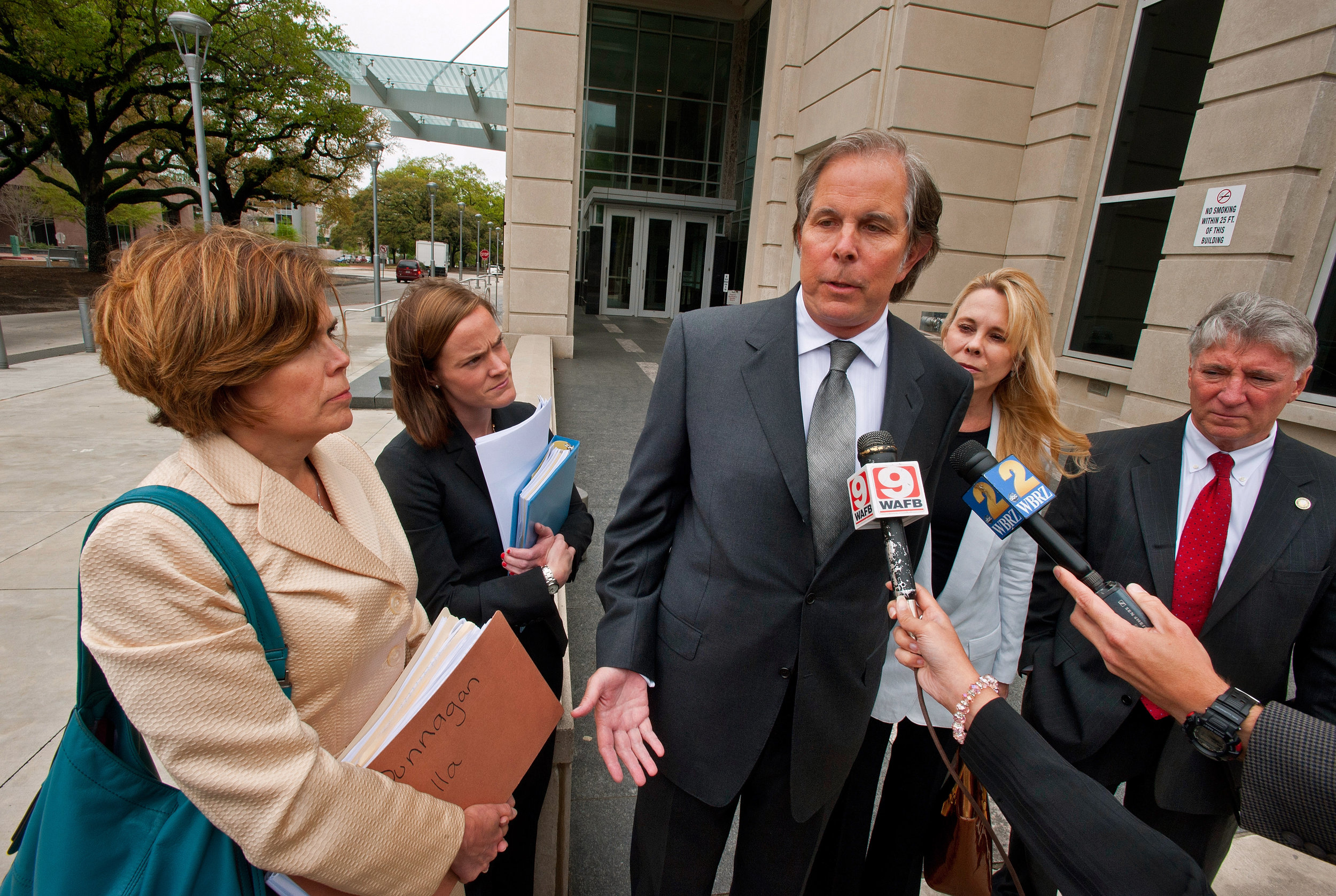 Ted Kergan, center, responds to media questions after Leila Mulla's indictment in April, 2014