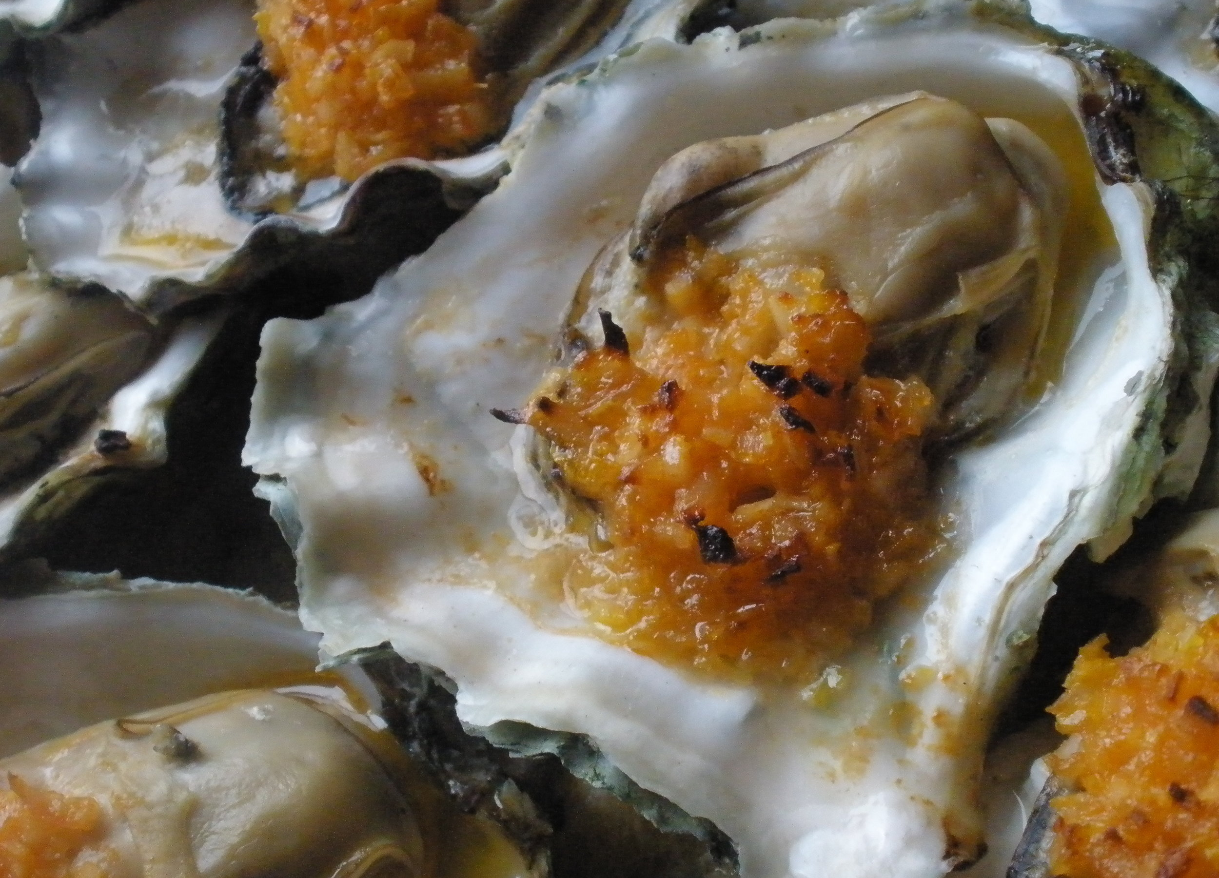 Broiled oyster with compound butter.jpg