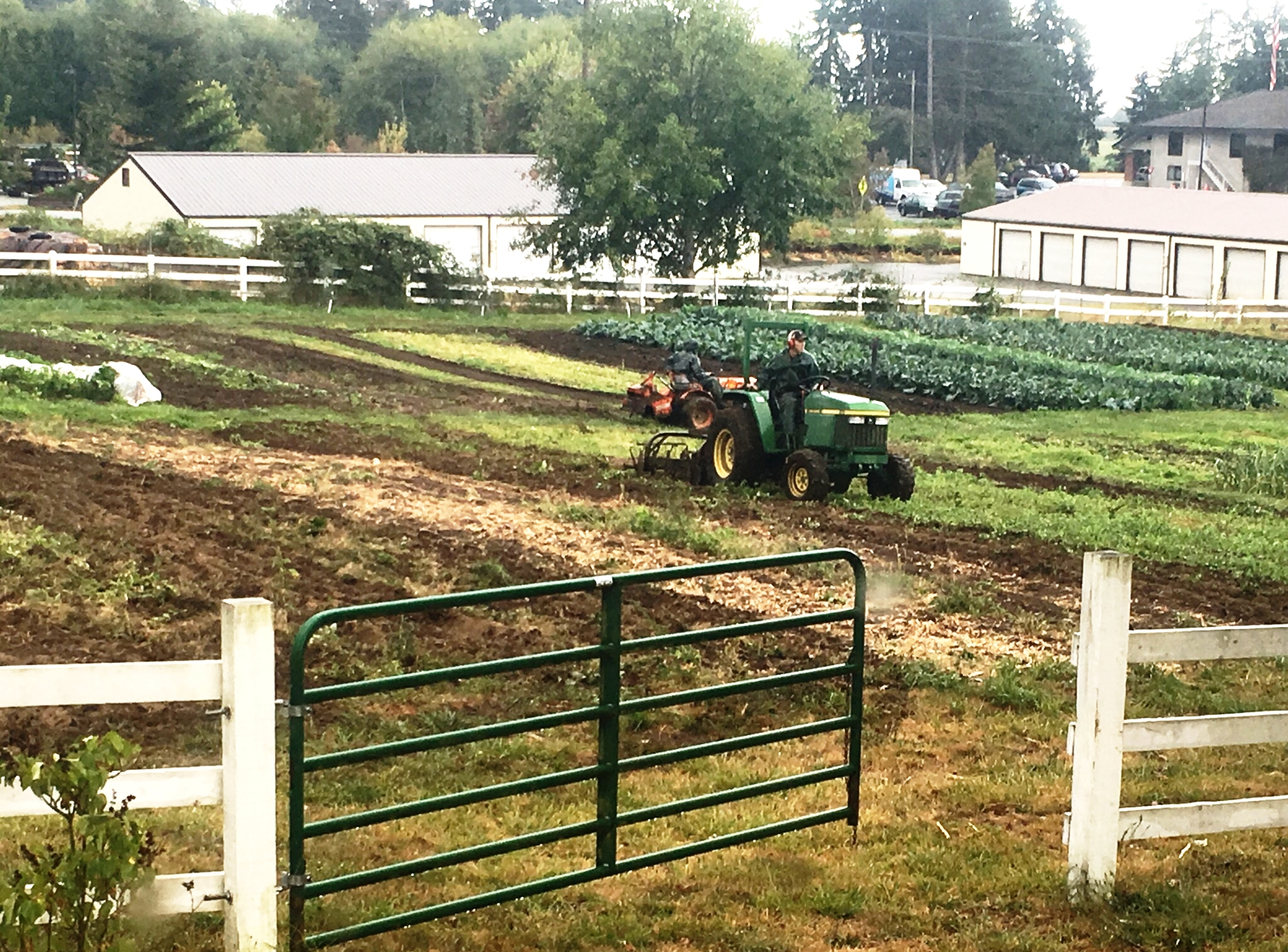 Ebb Tide Produce plowing the field.