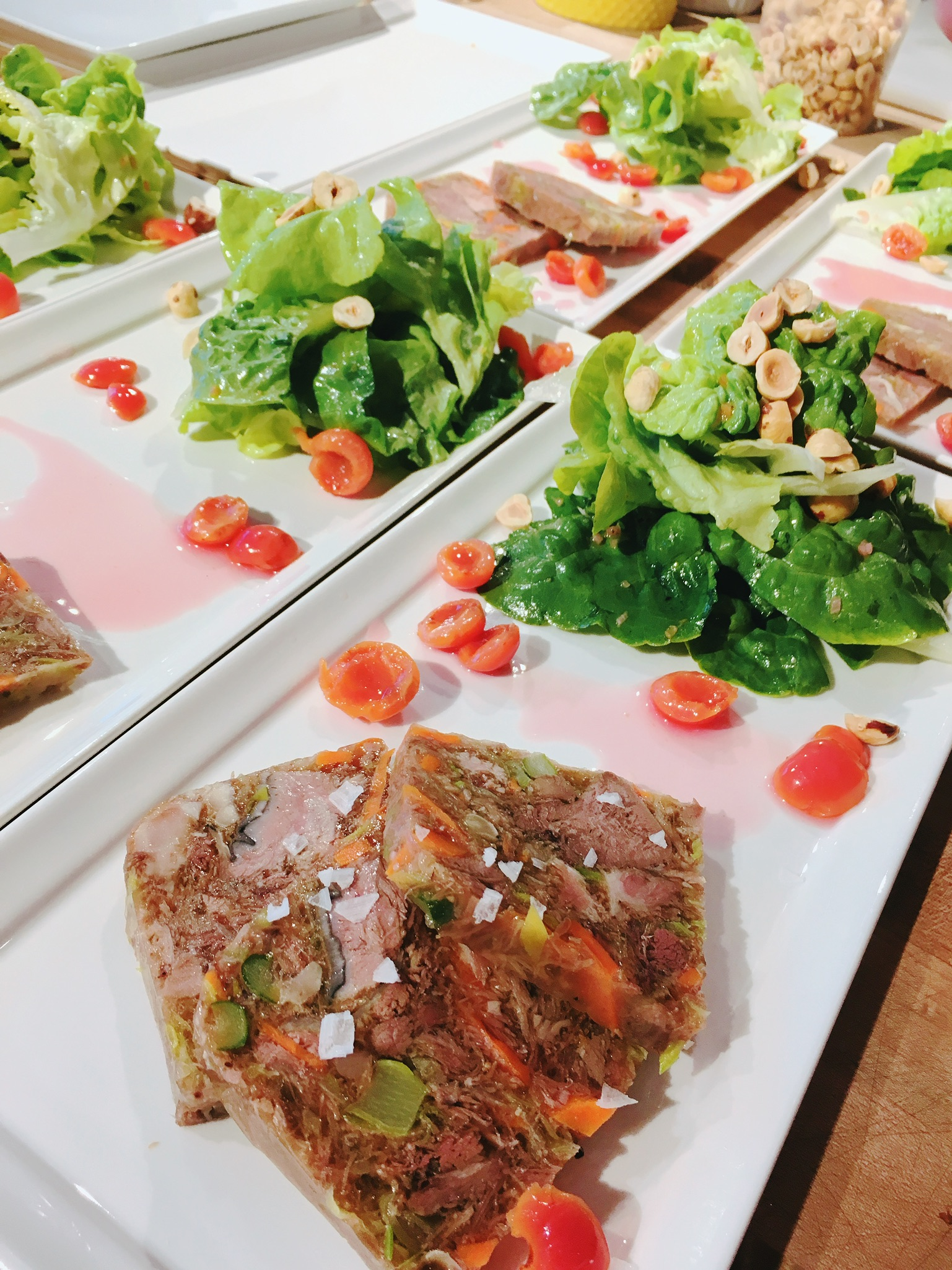 Terrine with picked pie cherries, butter lettuce and hazelnuts