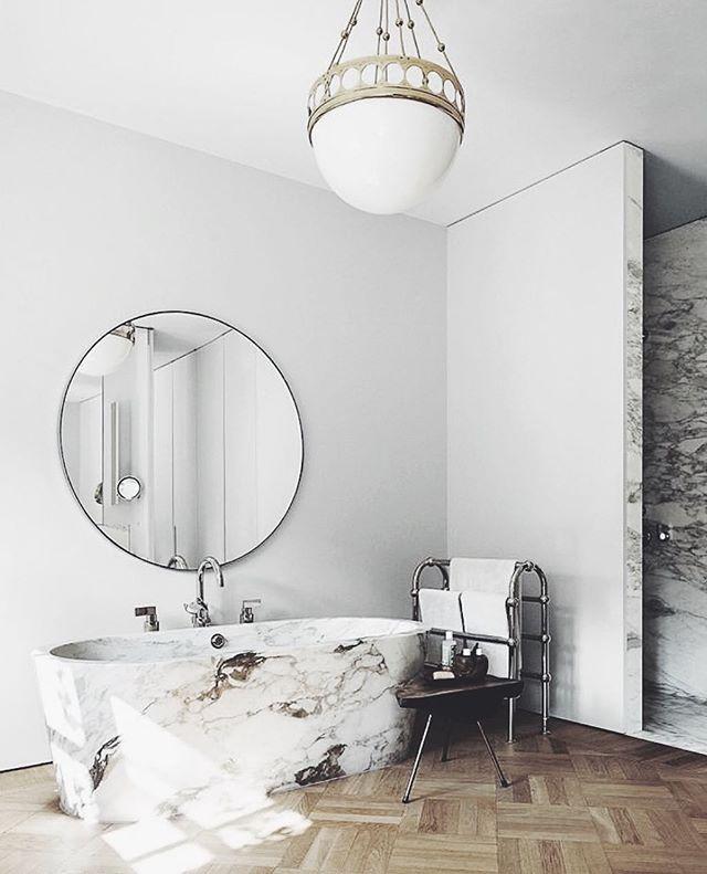 The ultimate Sunday spot 💭 Stockholm apartment by #ilsecrawford . . . . . . //#interiordesign #monochromeliving #scandinaviandesign #bathroomdesign #stockholm #modern #woodfloors #marble #dailyinspiration #interior #stockholminteriors #interiordesigner