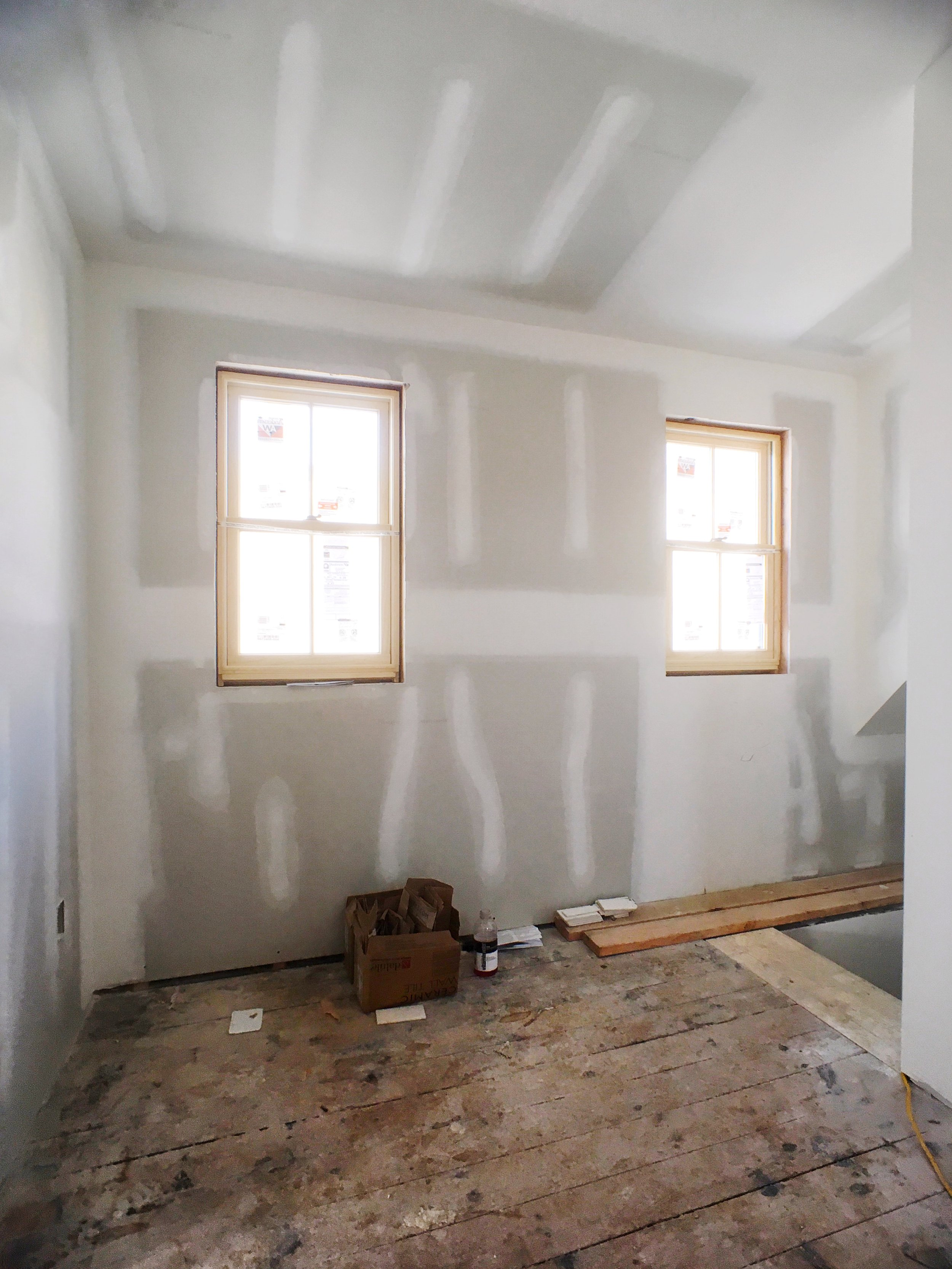 Dormer windows provide some much needed light to the 3rd floor hall and stairwell. We are excited to make this into a little reading nook. Soon enough you will find us sipping tea here in the evenings.