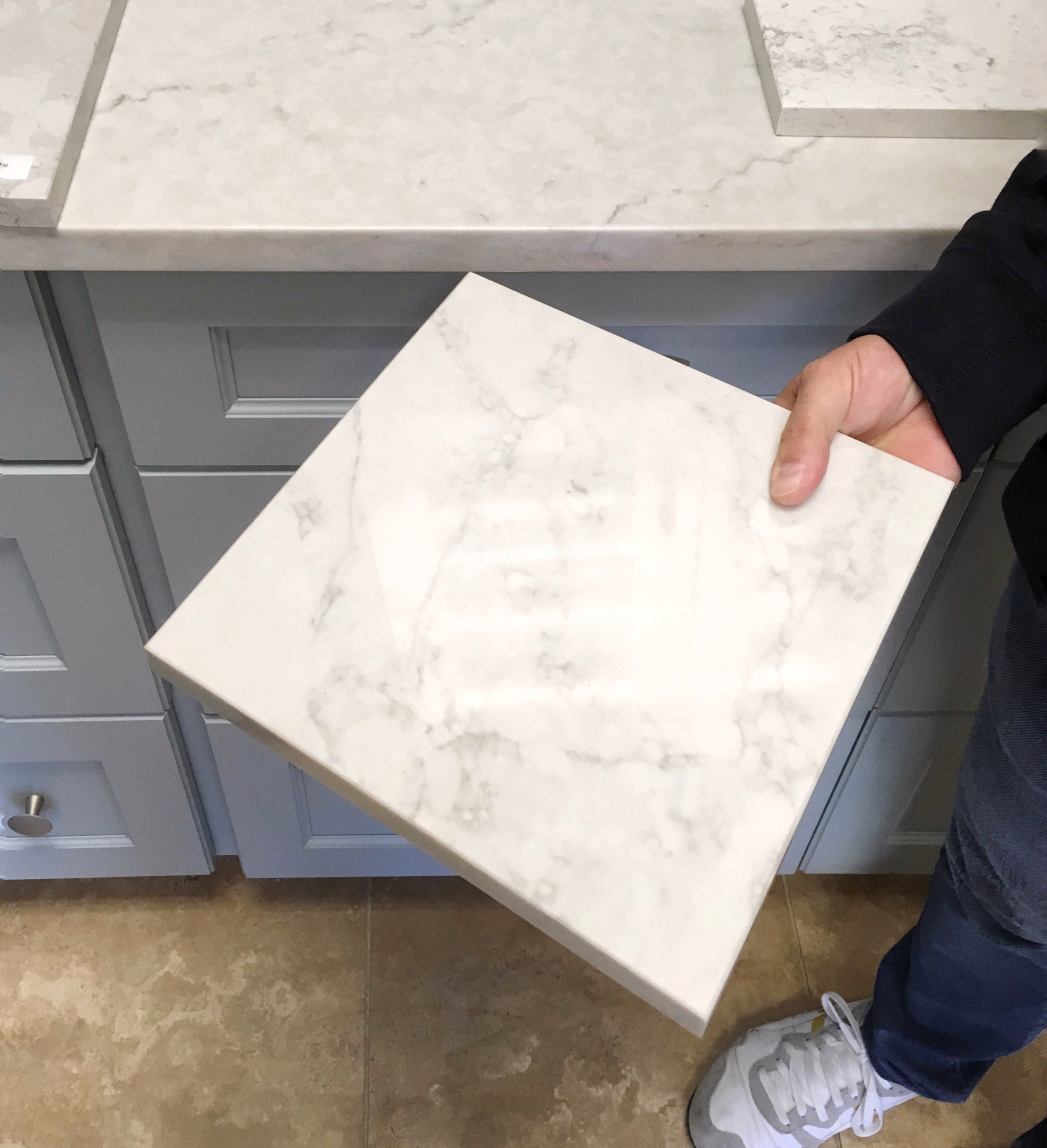 Owen showing off some quartz samples at a kitchen supply showroom.