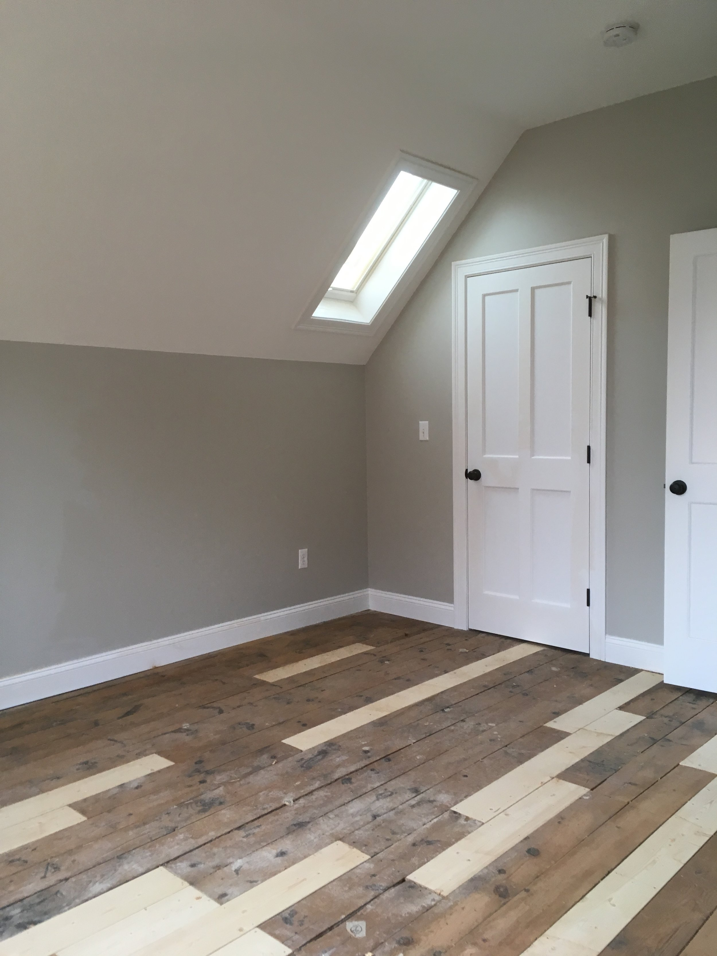 Original floor boards integrated with fresh white pine.