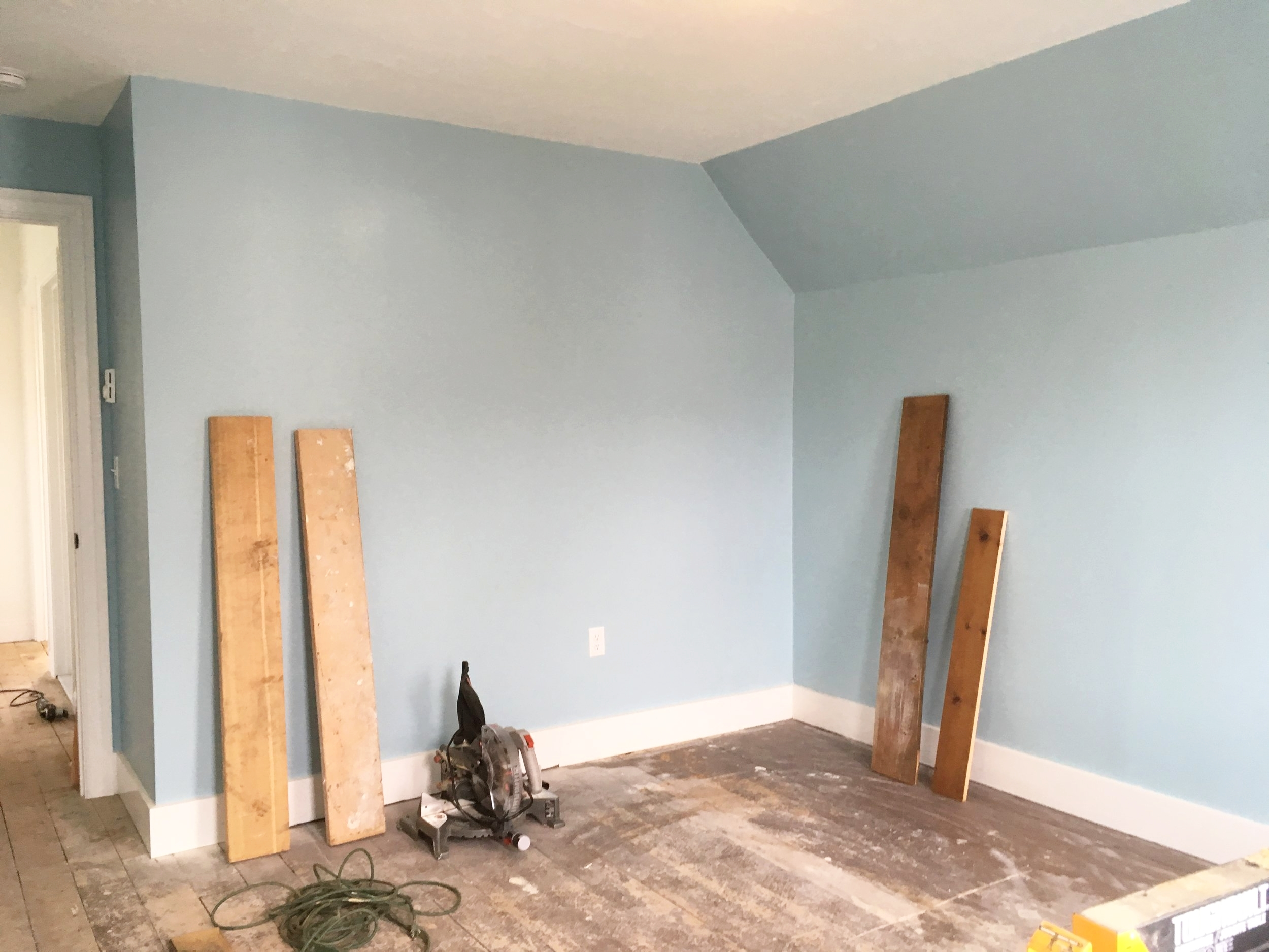 The guest room floor boards were painted at some point over the years, perhaps even as early as the 1940s. Stripping the paint to expose the original pine finish would prove to be a time consuming challenge but well worth it.
