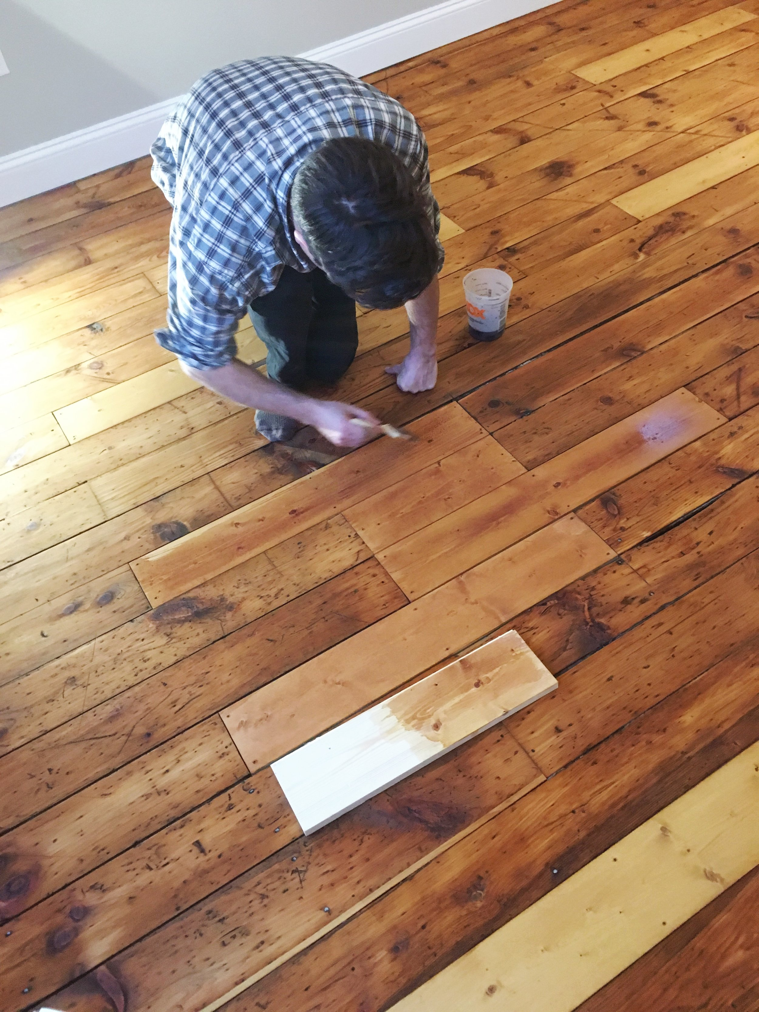 Owen brushes on the acrylic wash to the new, tea-stained boards.