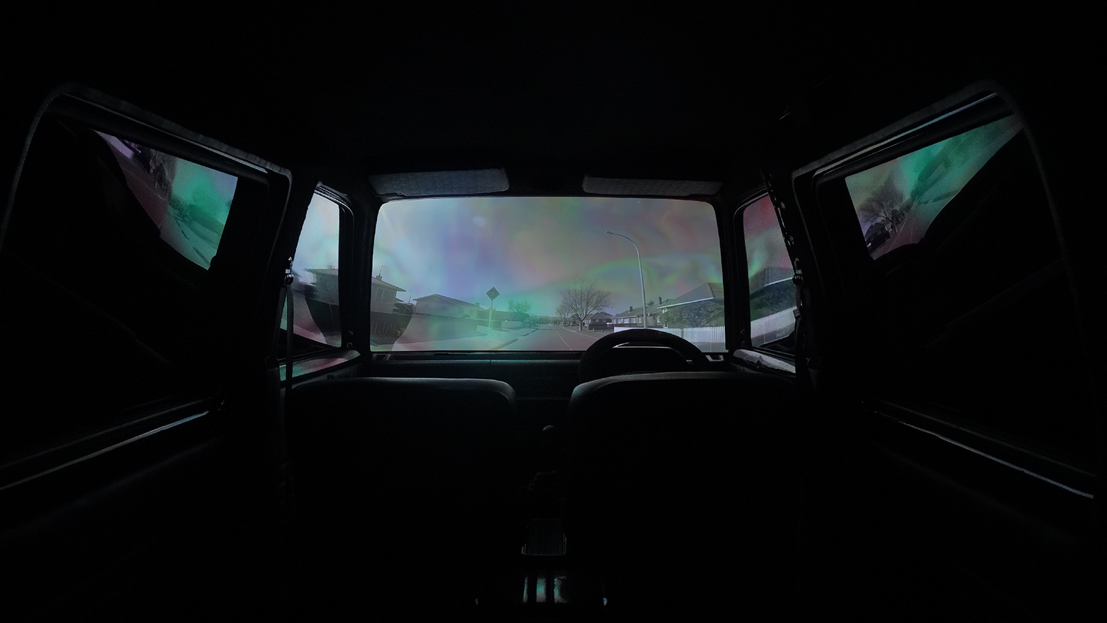 """Installation view of  TERRI TE TAU 's  Unwarranted and Unregistered , 2013,multimedia installation with music composed by Rob Thorne, dimensions variable, at """"Unwarranted and Unregistered: Te Āhua o te Hau ki Te Papaioea,"""" The Mangere Arts Centre, Auckland, 2015. Courtesy the artist."""