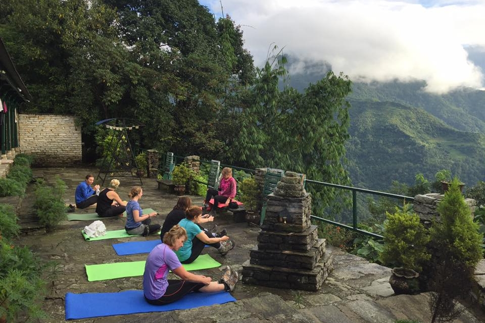 Yoga set against mountain views and nature