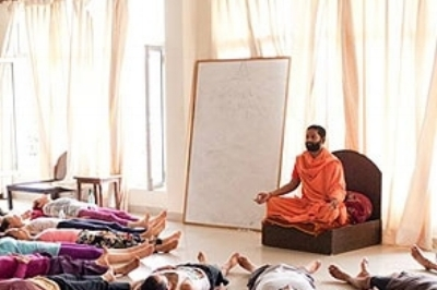 Receive teachings and a classes by the Swami