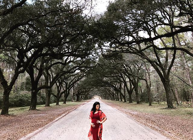 "Me and my baby daddy took a quick ""babymoon"" down to Savannah. All we did was eat but I do have this one pic of me being super basic posing in front of this oak lined road dripping with spanish moss. So, there's that."