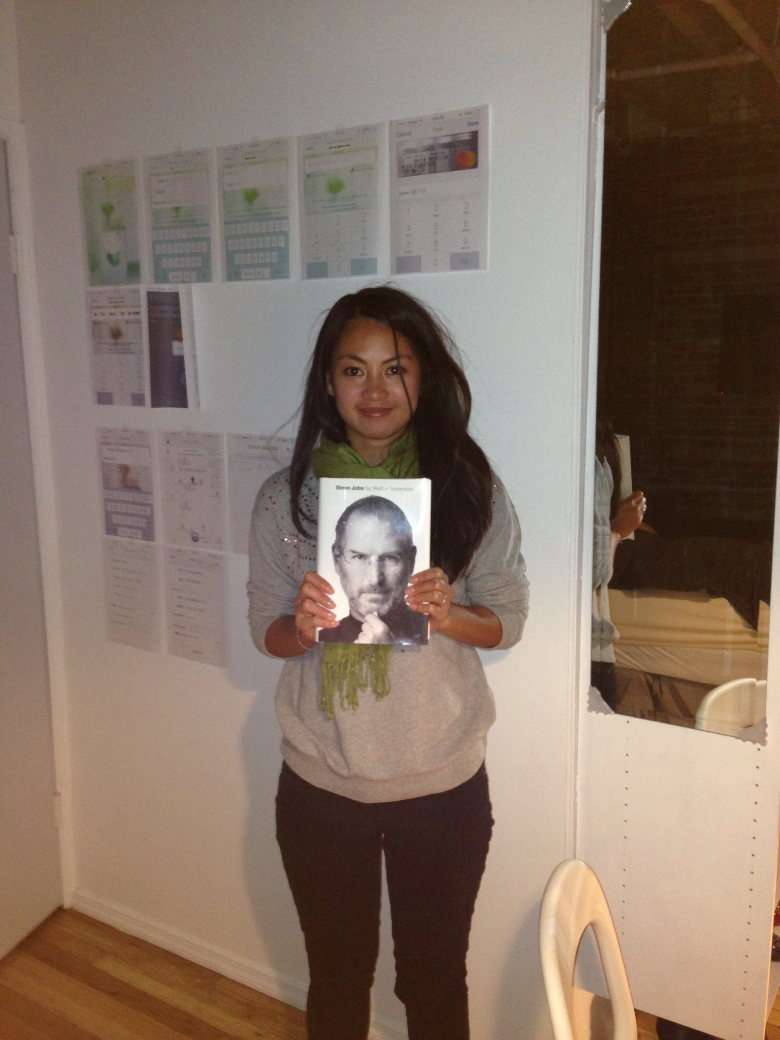 taken on Oct. 23, 2013   This is me holding up the Steve Jobs biography. I read it 3 times, always imagining that he was my mentor. You can see initial screenshots of the first version of the app behind me.