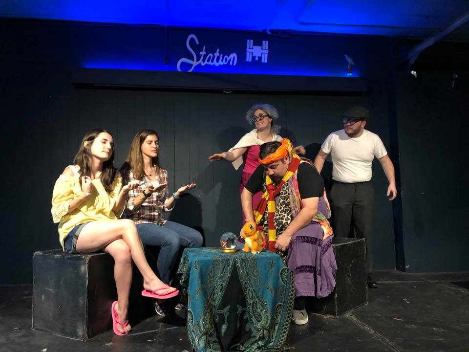 The Madame (David Toscano) is plagued by annoying spirits (Cassie Randall and Dustin Blanton,) and dumb patrons (Tamara Wharton and Sarah Willet,) in the final scene from  The Lioness, The Witch, and the Lumpy Milk.