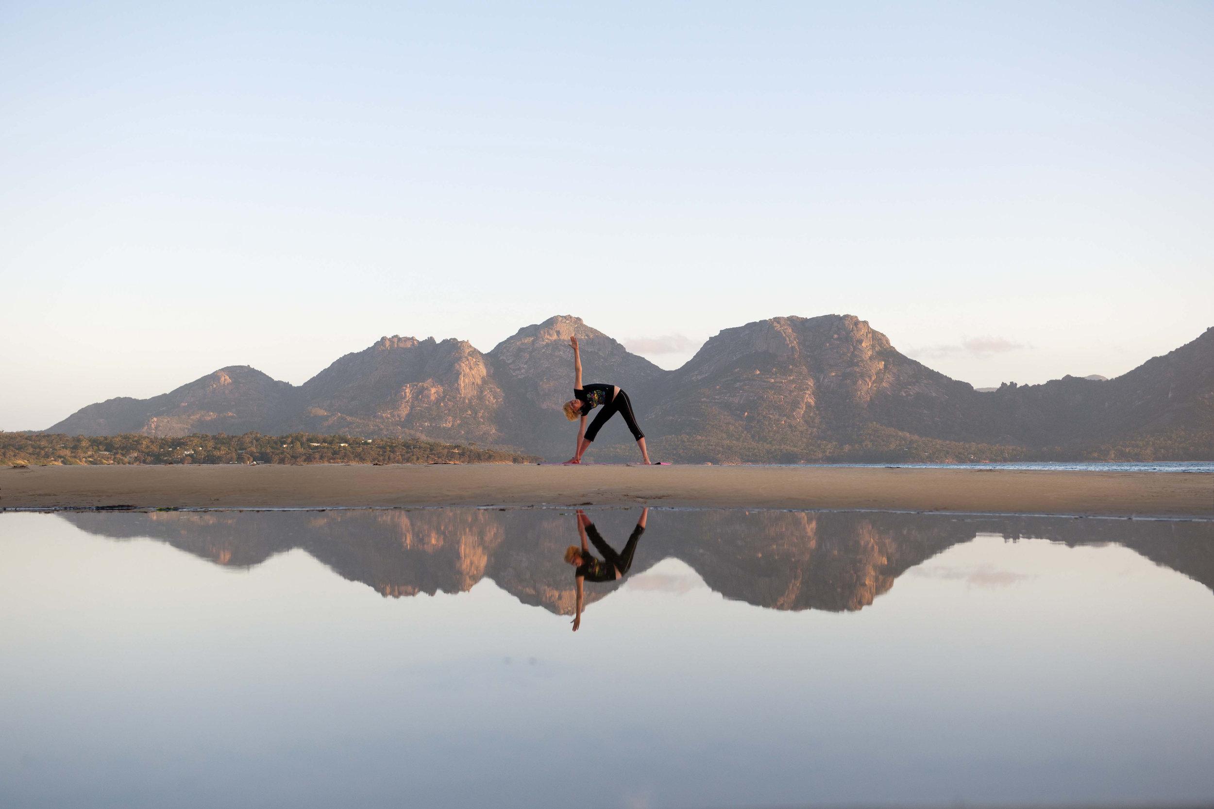 saffire-freycinet_yoga-on-muirs-beach.jpg