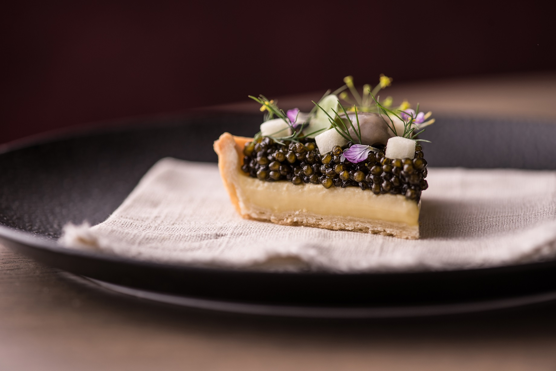 Oyster Pie ( a savory oyster custard topped with osetra caviar, a touch of creme fraiche, green apple dressed with lemon & dill ): Photo credit Anthony Tahlier