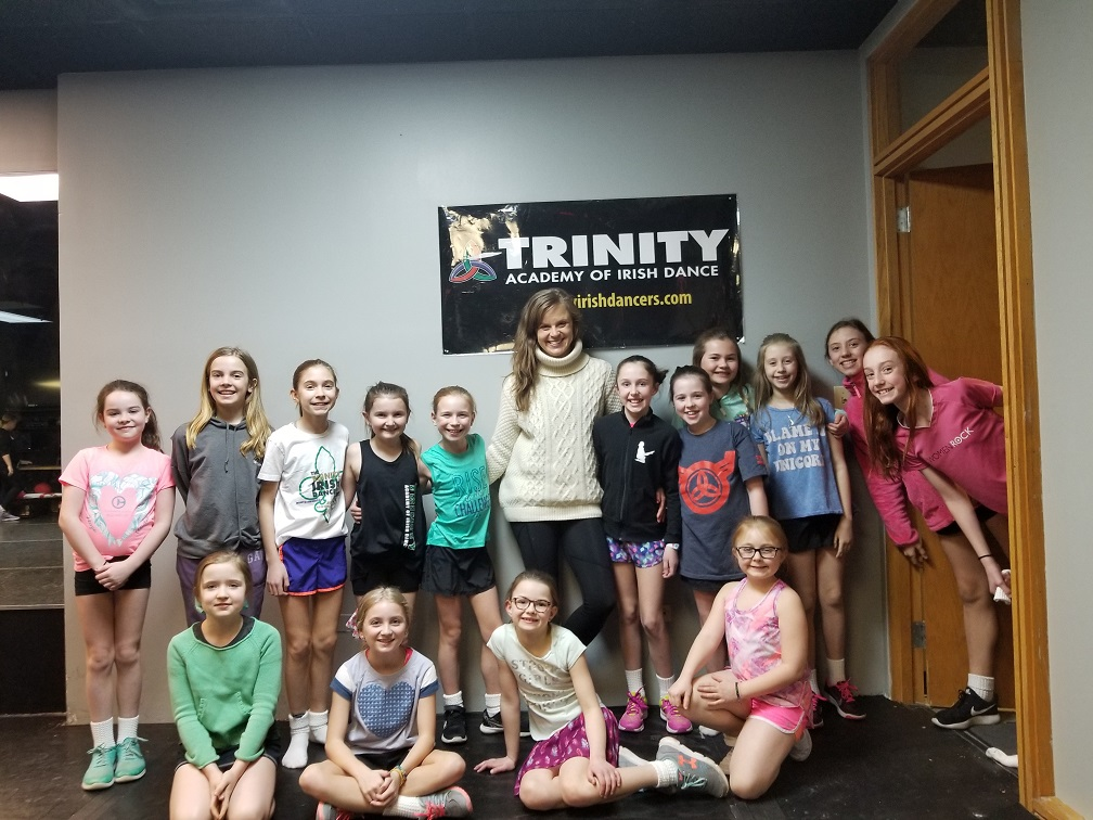 Trinity Academy of Irish Dance director Natalie Howard (center) with students