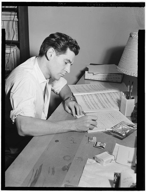 Leonard Bernstein in his New York apartment between 1946-48. Photo by William Gottlieb.