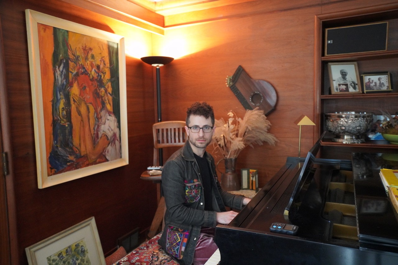 Greg Spero at the piano he played as a child at his grandparents' Highland Park home.