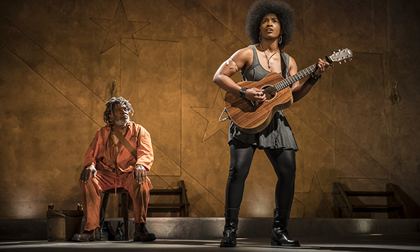 "Ernest Perry Jr. (The Oldest Old Man) and Melody Angel (Musician) in ""Father Comes Home from the Wars (Parts 1, 2 & 3)"". Photo courtesy of Goodman Theatre."