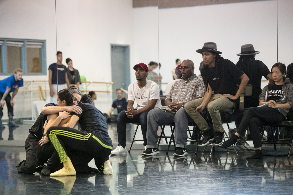 John Boogz and Lil Buck with others watching a rehearsal