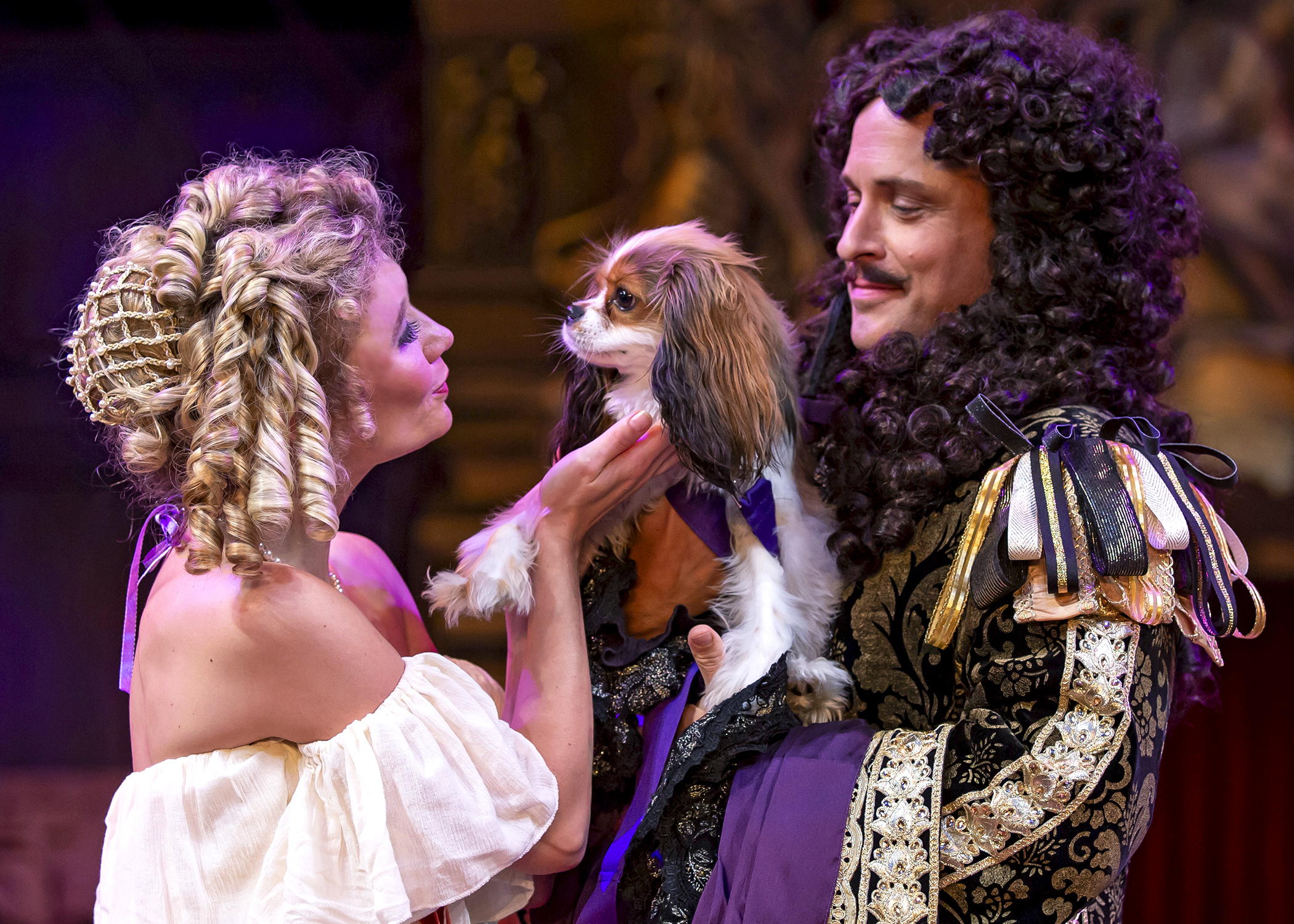 Nell Gwynn (Scarlett Strallen) and King Charles II (Timothy Edward Kane) embrace the royal spaniel in Chicago Shakespeare's production of  Nell Gwynn . Photo by Liz Lauren.