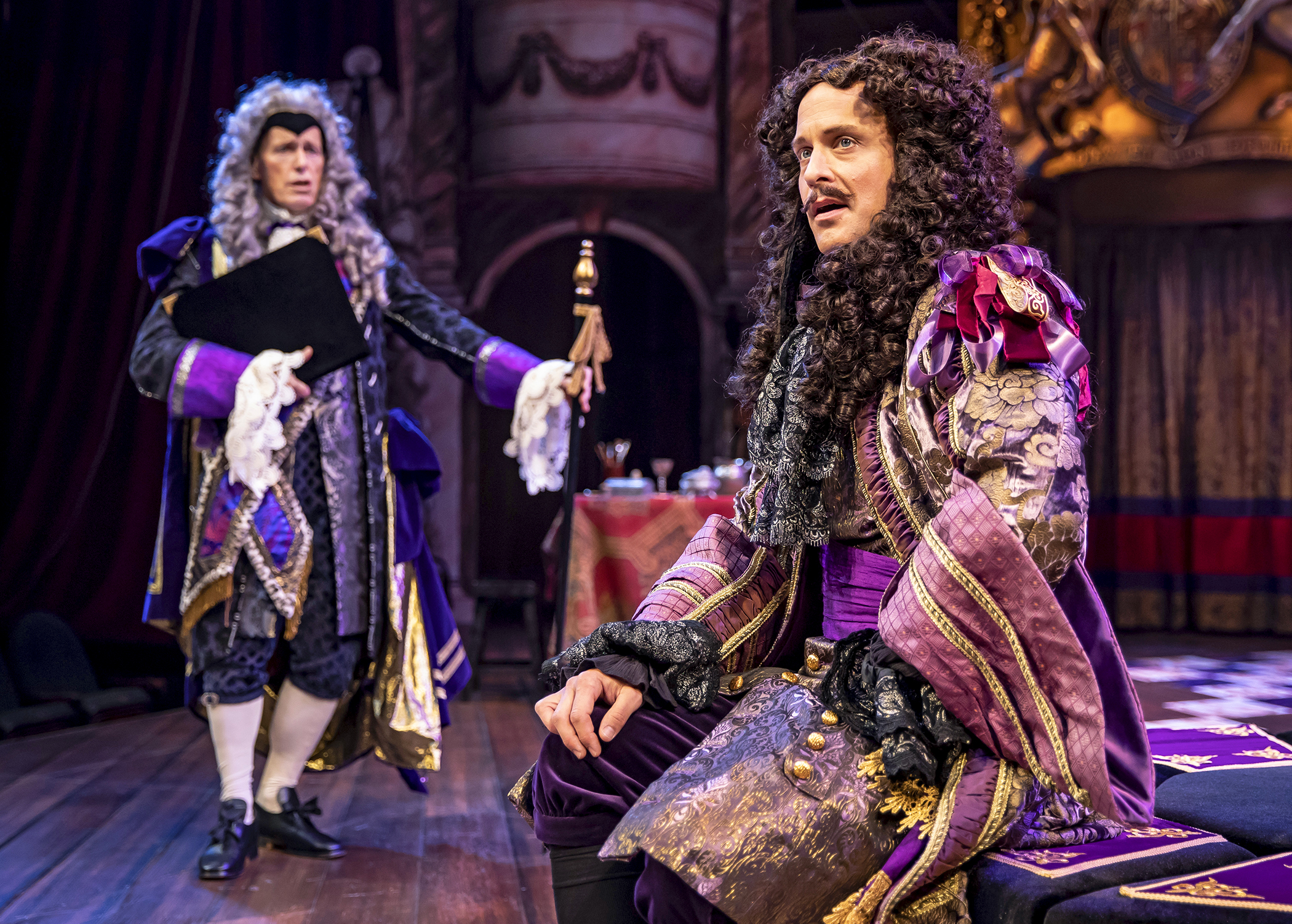 King Charles II (Timothy Edward Kane) rebuffs his advisor Lord Arlington (Larry Yando) in Chicago Shakespeare's production of  Nell Gwynn . Photo by Liz Lauren.