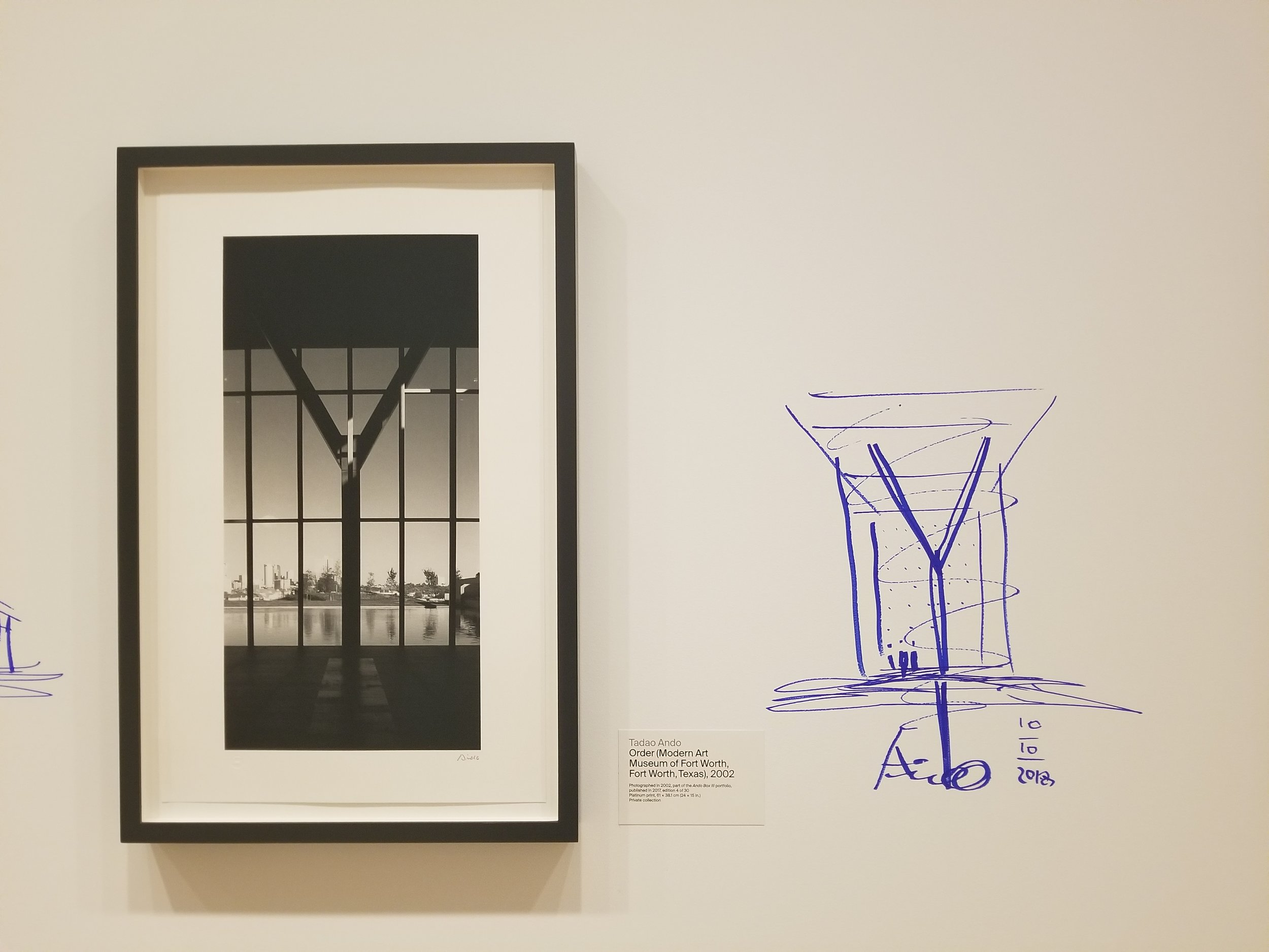 Ando's hand-drawn design next to a photo of one of his works.