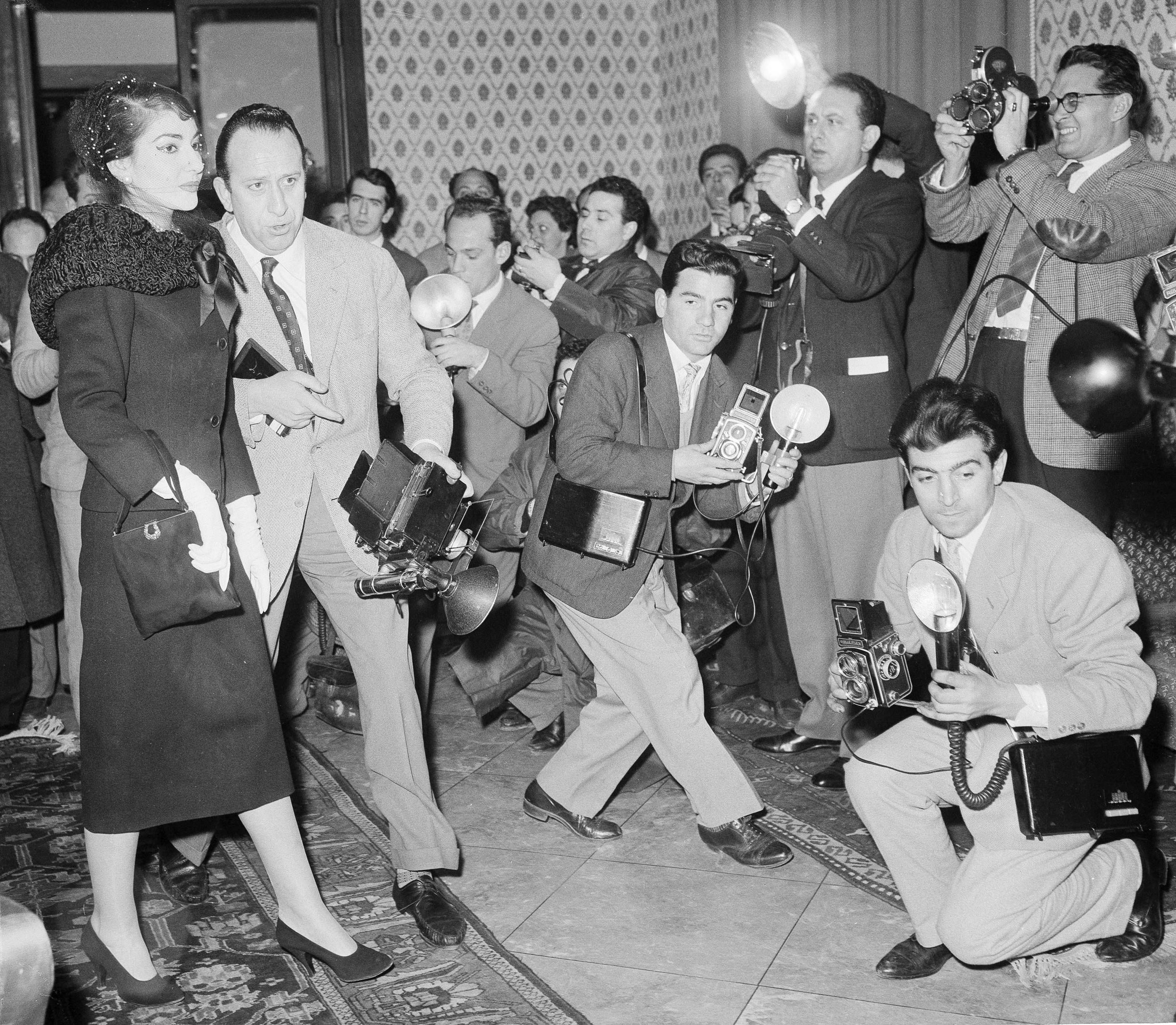 Maria Callas dealing with a gaggle of reporters