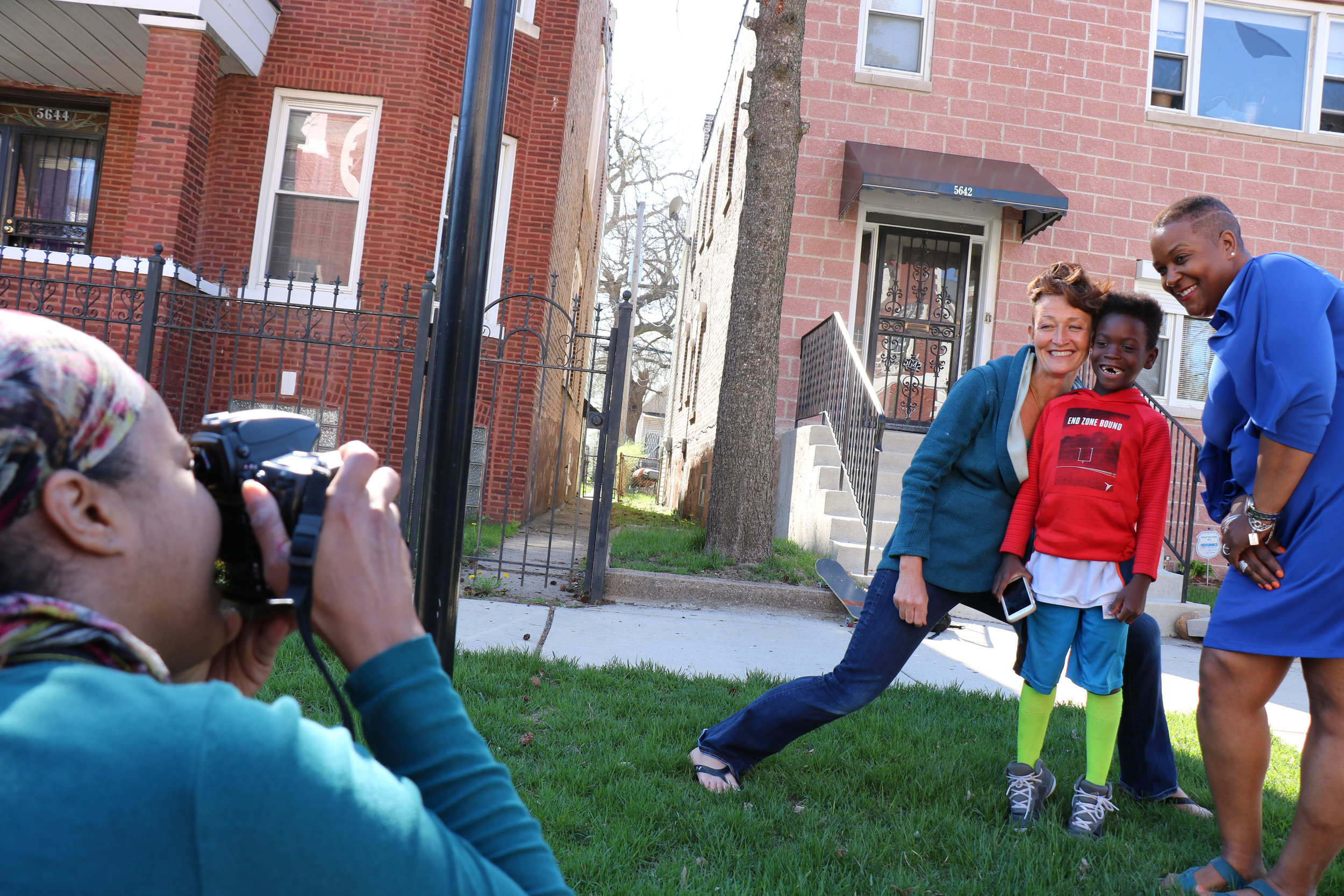 Folded Map Project participants Carmen Arnold-Stratton (right) of the 5600 block of S. Winchester in Englewood, and Brighid O'Shaughnessy (left) of the 6500 block of N. Winchester in Rogers Park embrace after their first visit in Arnold-Stratton's Englewood community. Courtesy of Tonika Lewis Johnson.