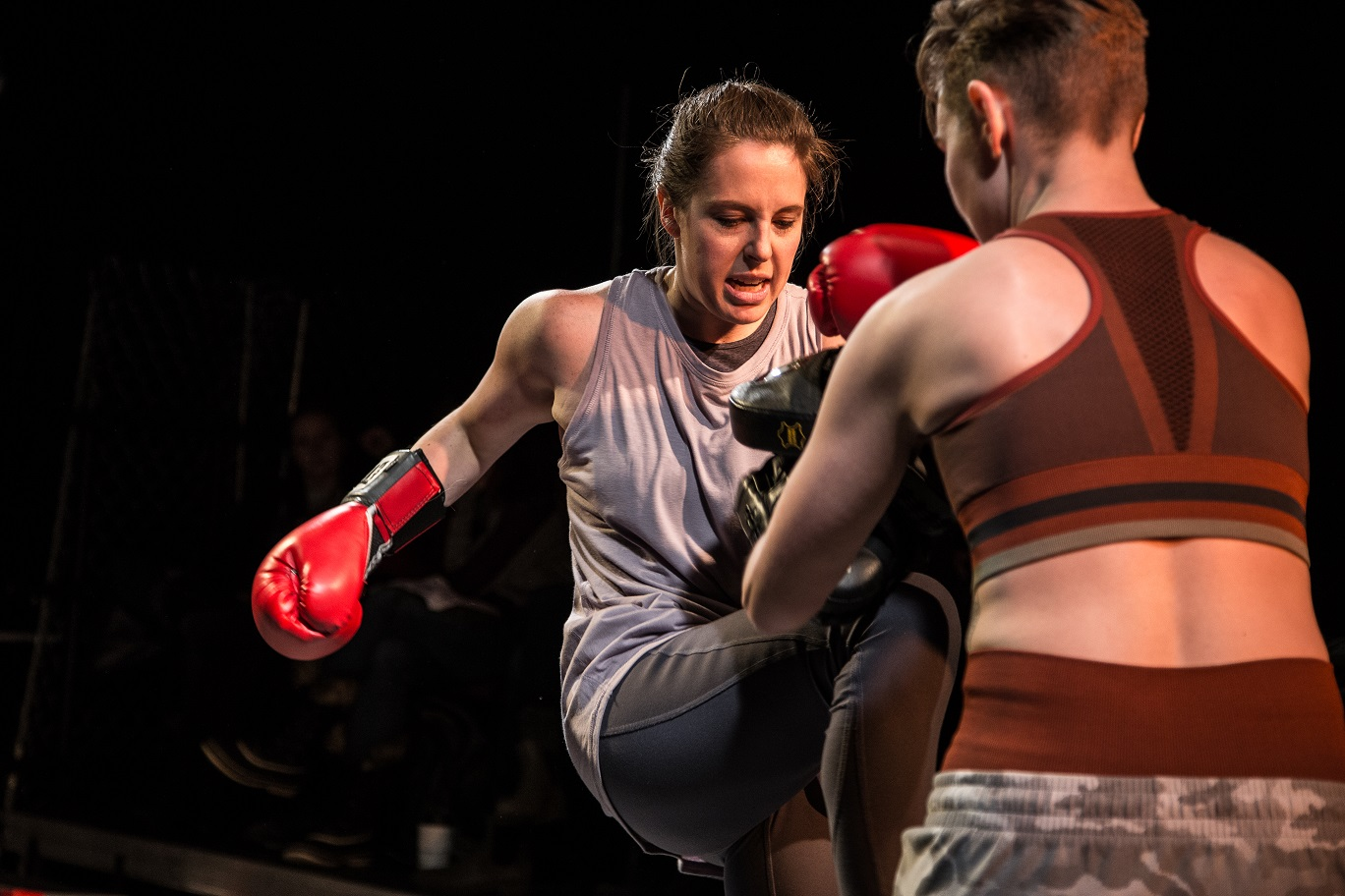A scene from Broken Nose Theatre's GIRL IN THE RED CORNER. Photo Credit: Austin D. Oie