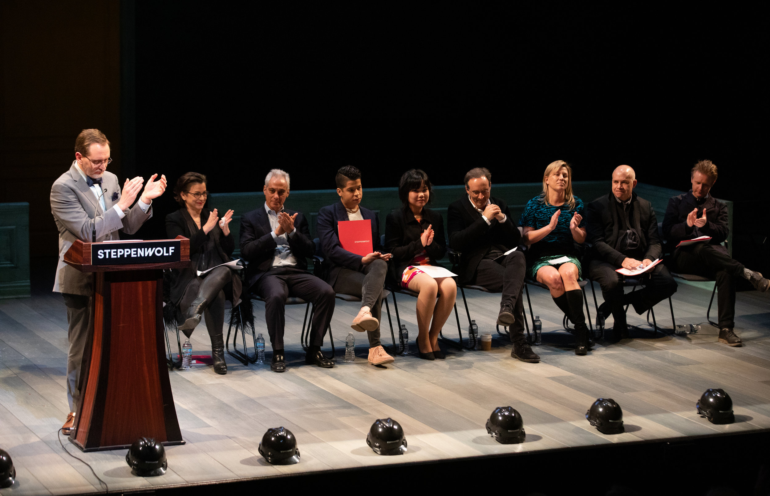 Steppenwolf Executive Director David Schmitz shares remarks at the company's groundbreaking event. Pictured on stage with David (L to R): Artistic Director and ensemble member Anna D.Shapiro, Mayor Rahm Emanuel, Steppenwolf Young Adult Council alum Brandon Rivera and current member Maiya Swedberg, Campaign Co-Chairs Eric Lefkofsky & Nora Daley, Gordon Gill architect with Adrian Smith + Gordon Gill Architecture, and Gavin Green theater designer.  Photo Credit: Kyle Flubacker