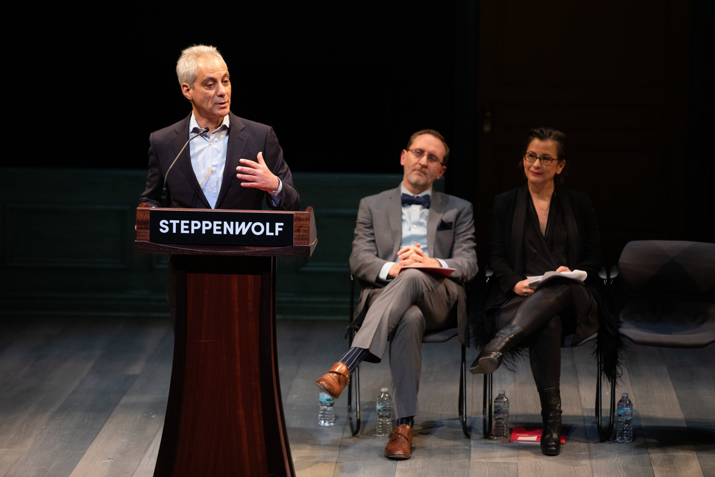 Mayor Rahm Emanuel shares remarks at Steppenwolf's groundbreaking event, March 5, 2019. Pictured seated (L to R): Steppenwolf Executive Director David Schmitz and Artistic Director Anna D. Shapiro. Photo Credit: Kyle Flubacker