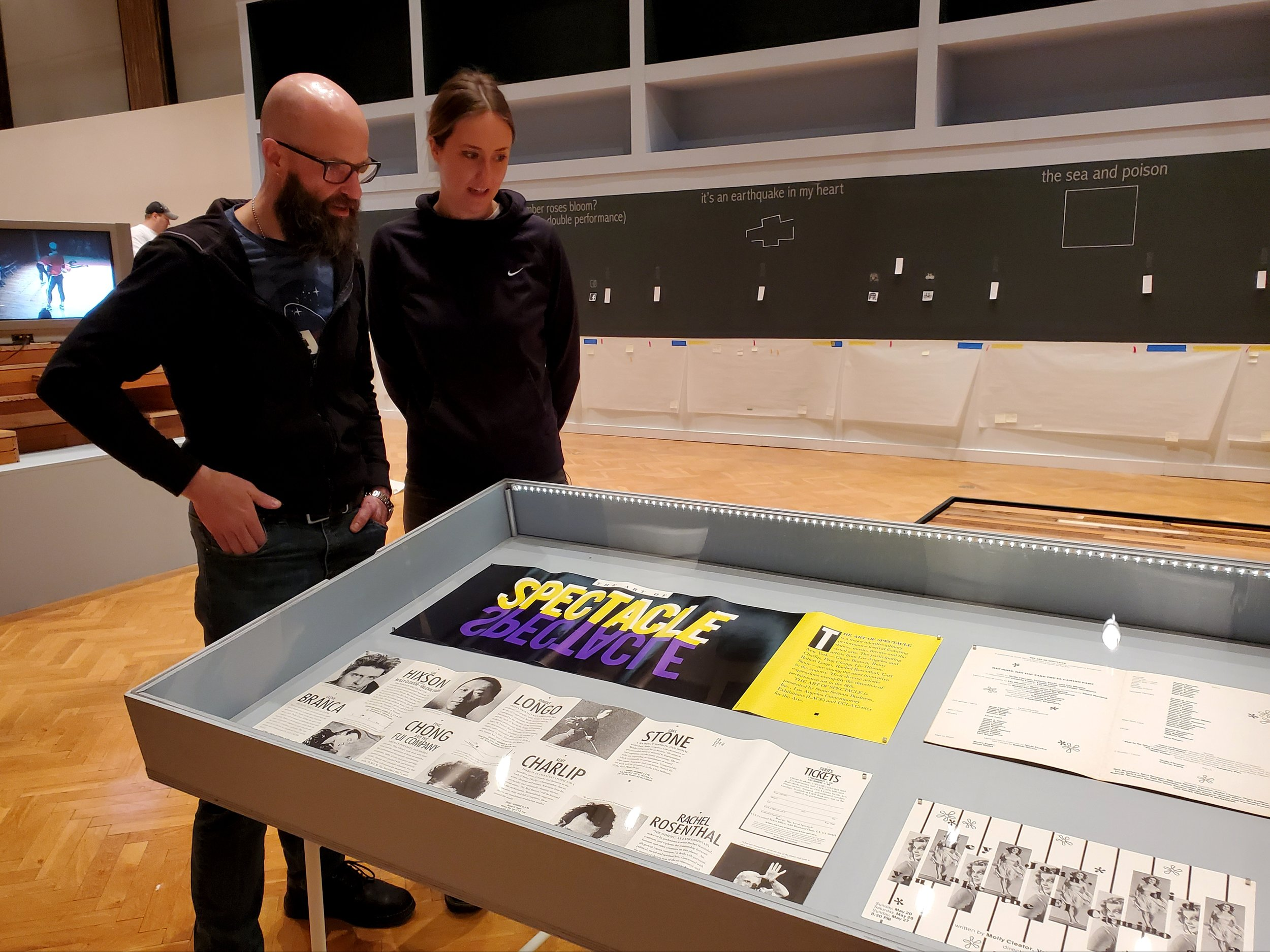 Goat Island Archive curator Nicholas Lowe and Sarah Skaggs looking at one of the Goat Island Archive displays