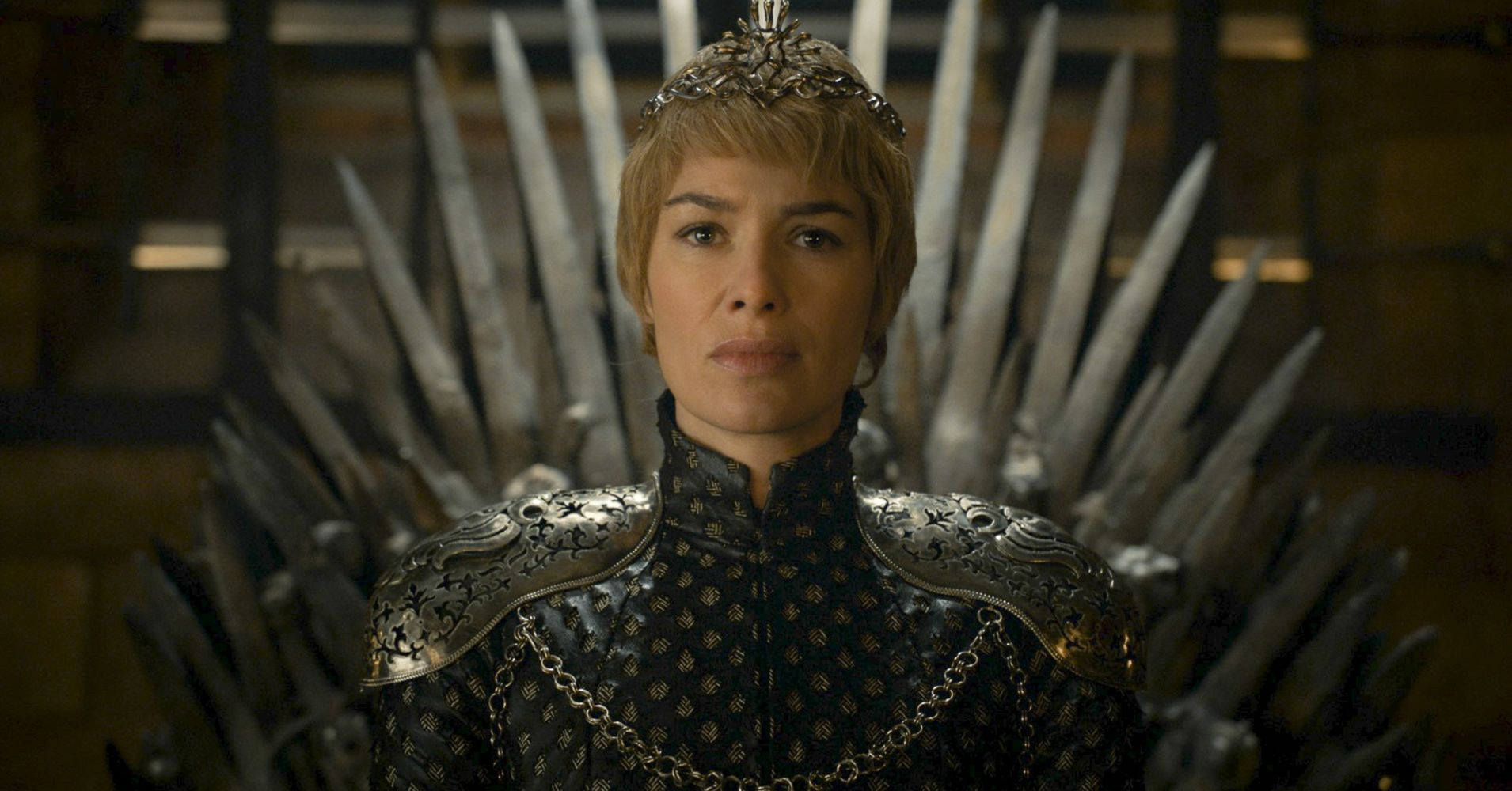 Lena Headey as Cersei Lannister sitting on the throne in Game of Thrones