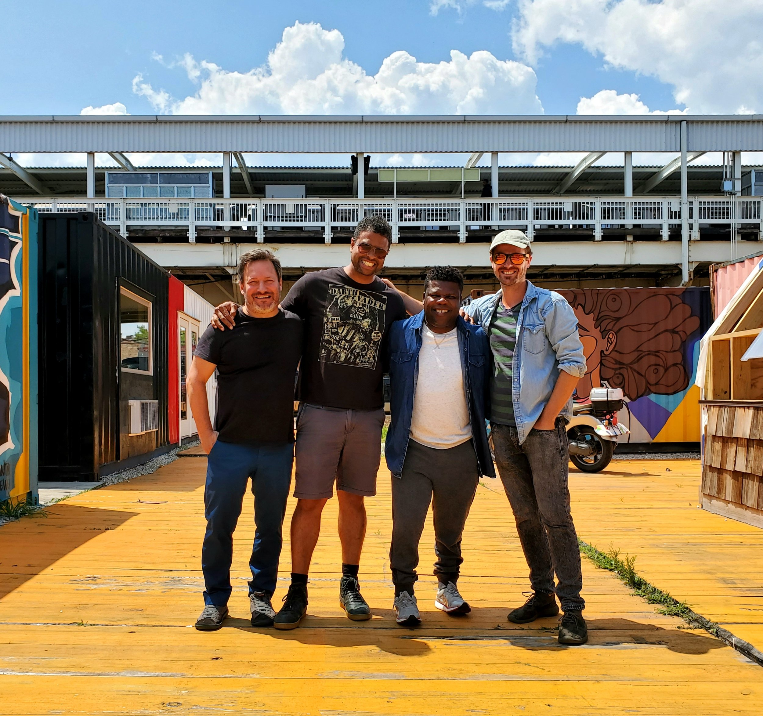 Floating Museum directors (left to right): Andrew Schachman, Faheem Majeed, Avery R. Young, and Jeremiah Hulsebos-Spofford at Boxville next the CTA Green Line station at 51st Street.